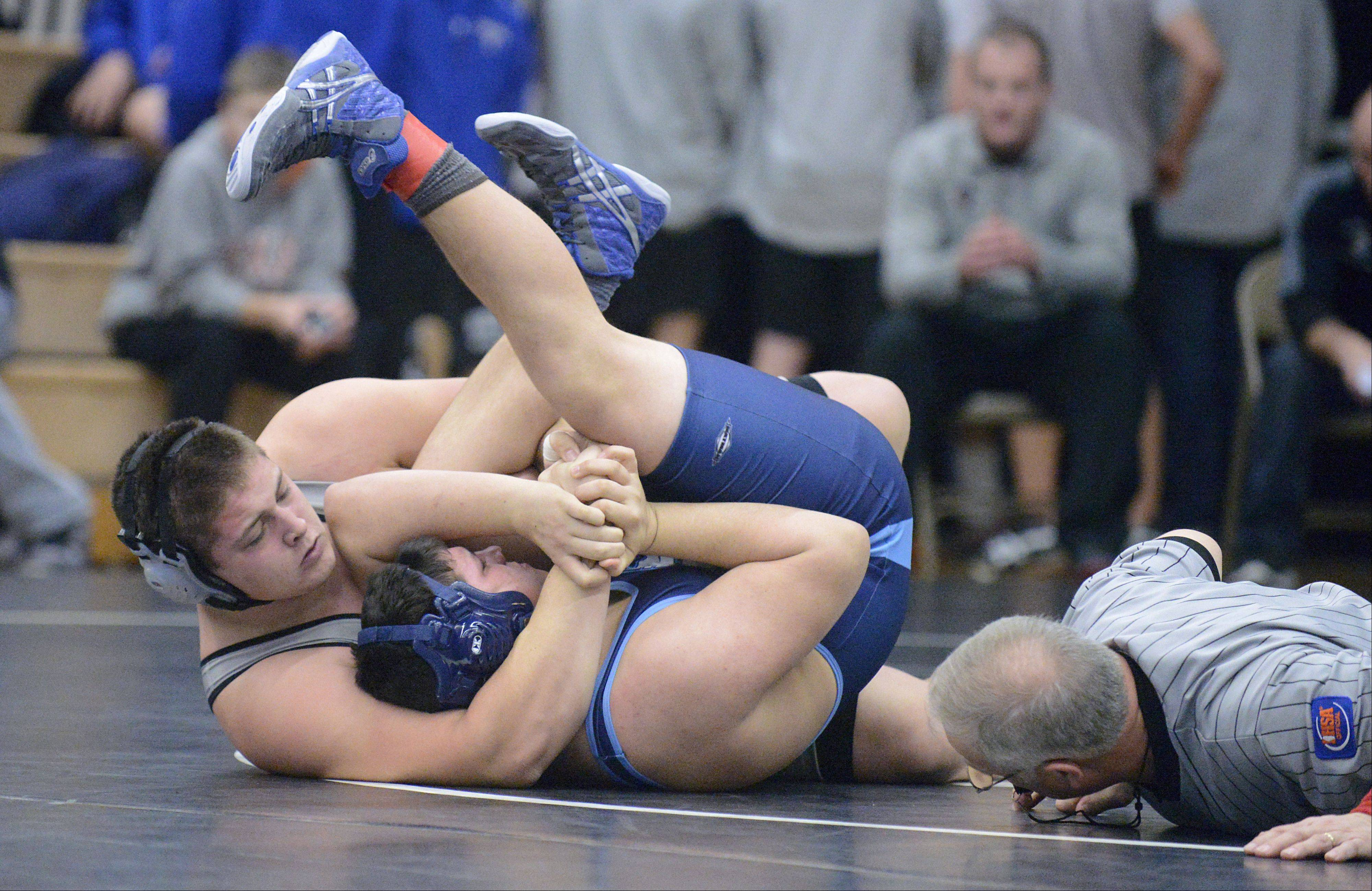 Kaneland's Zach Theis takes Prairie Ridge's Grant Rickets in the 285 pound match on Saturday, January 12.