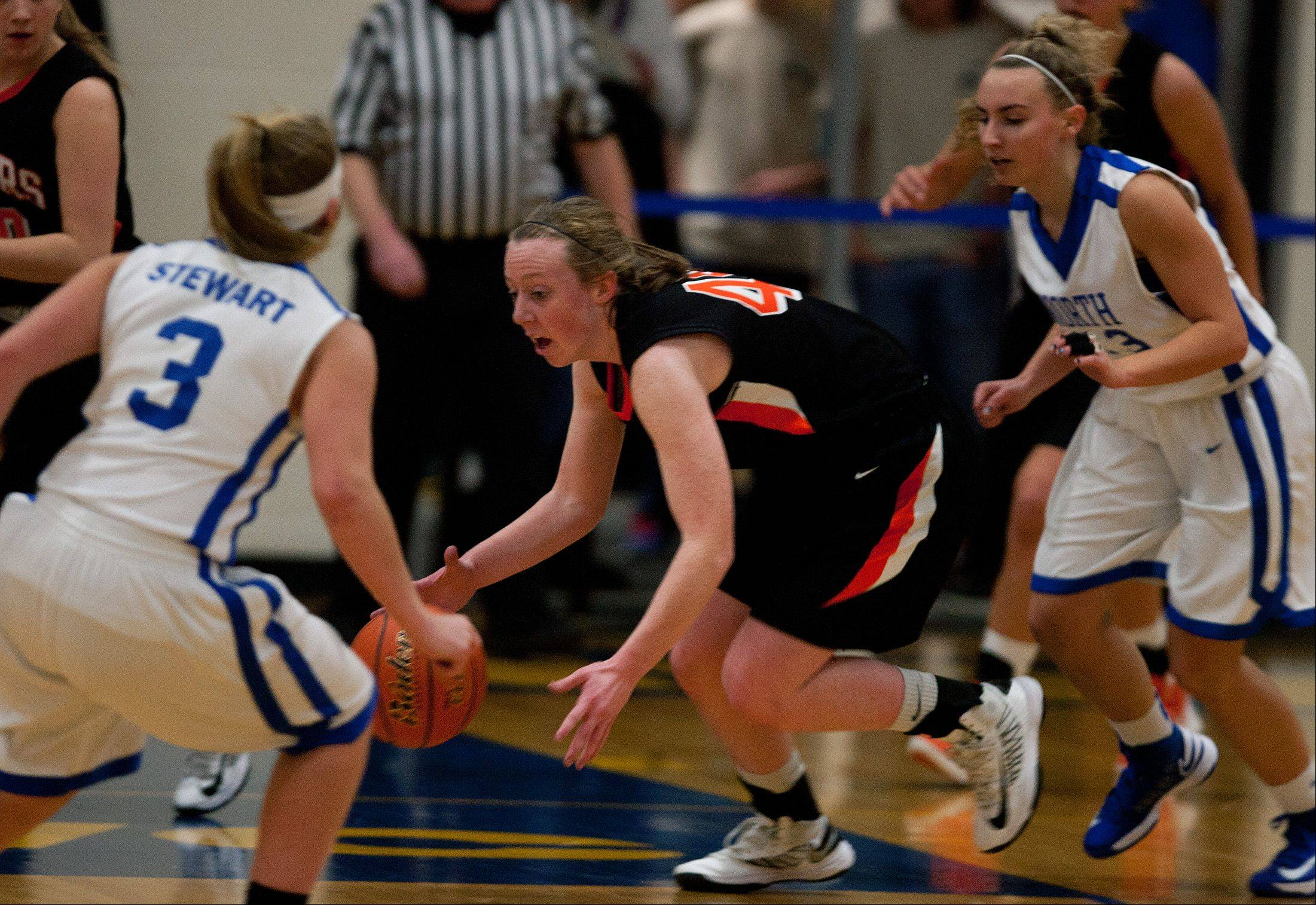 Wheaton Warrenville South's Olivia Linebarger (44) dribbles through the Wheaton North defense, during girls basketball action in Wheaton.