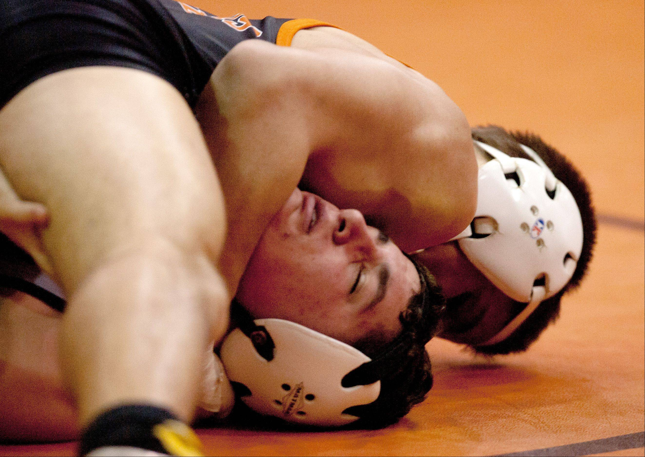 Wheaton Warrenville South's Cain Bialas, top, works to pin Lake Park's Will Heidenreich at the 160 weight, during the Wheaton Warrenville South wrestling quad.