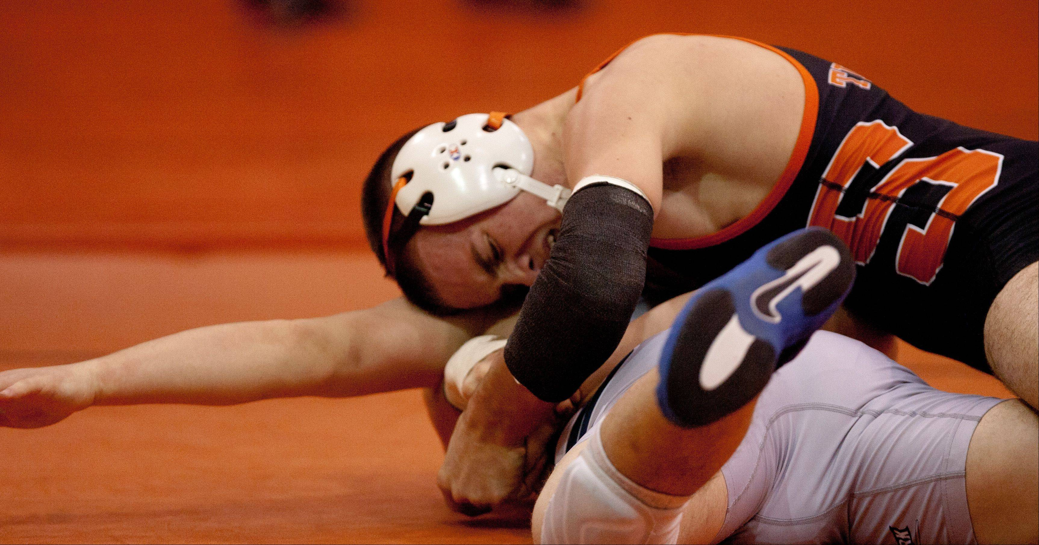 Wheaton Warrenville South's Camden Johnnic works to pin Lake Park's Kevin Korney at the 152 weight, during the Wheaton Warrenville South wrestling quad.