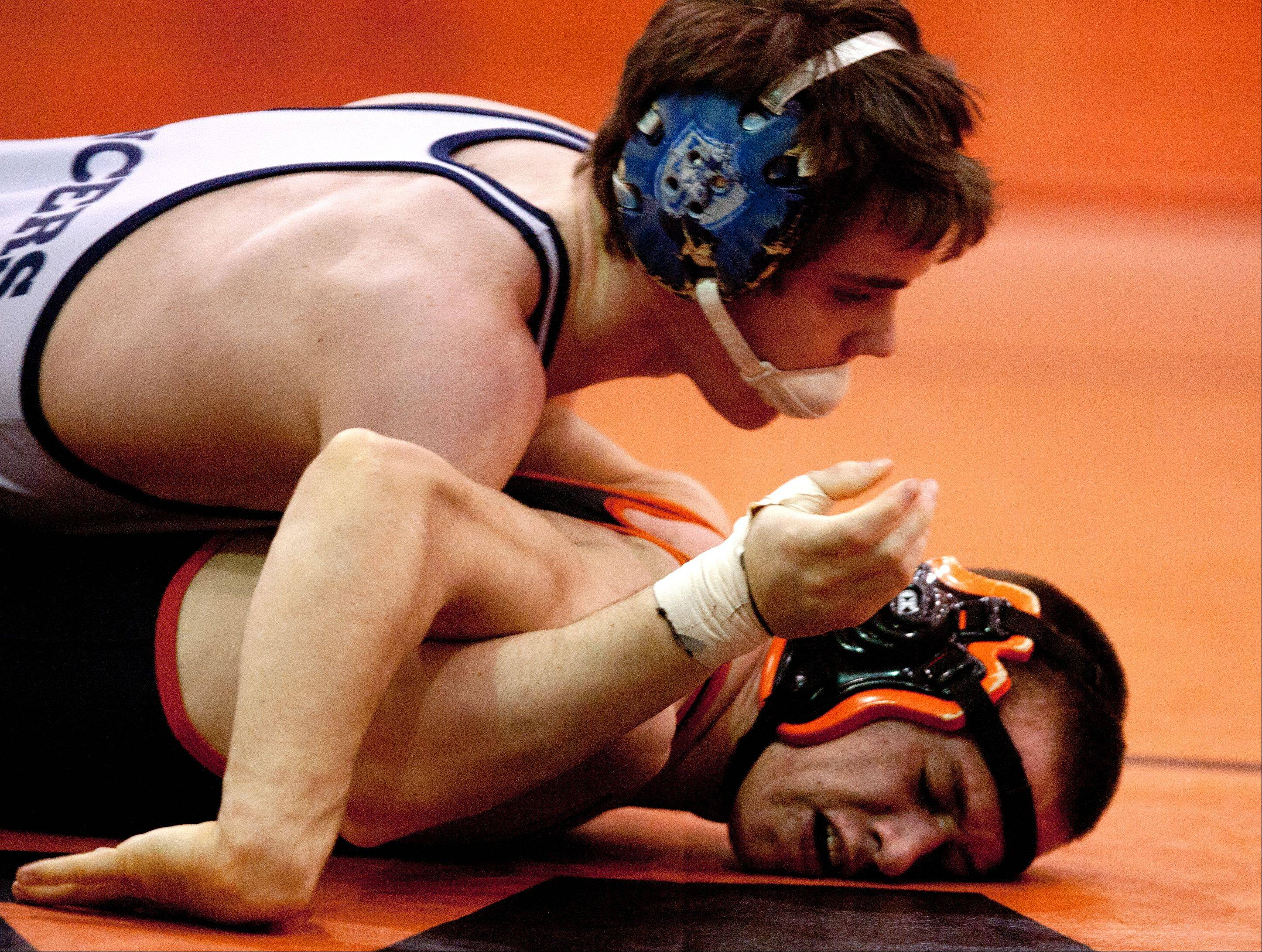 Lake Park's Austin Schoen, top, wins by decision over Wheaton Warrenville South's Andrew Ives at the 145 weight, during the Wheaton Warrenville South wrestling quad.
