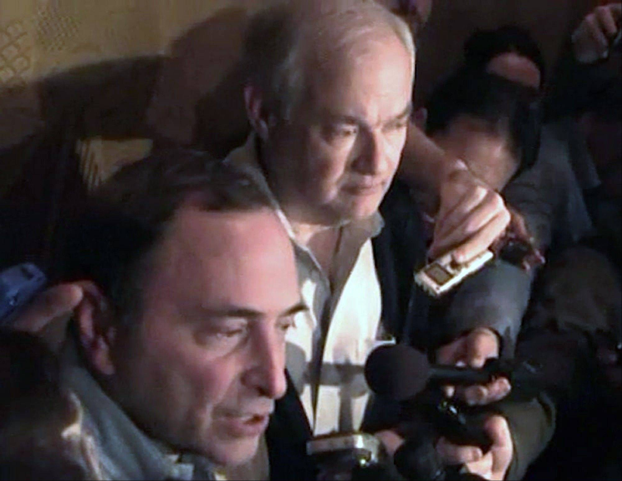 In this image from video, NHL commissioner Gary Bettman, left, talks to the media as Donald Fehr, executive director of the NHL Players' Association, stands next to him, in New York, early Sunday, Jan. 6, 2013. A tentative deal to end the 113-day NHL lockout was reached early Sunday morning following a marathon 16-hour negotiating session.