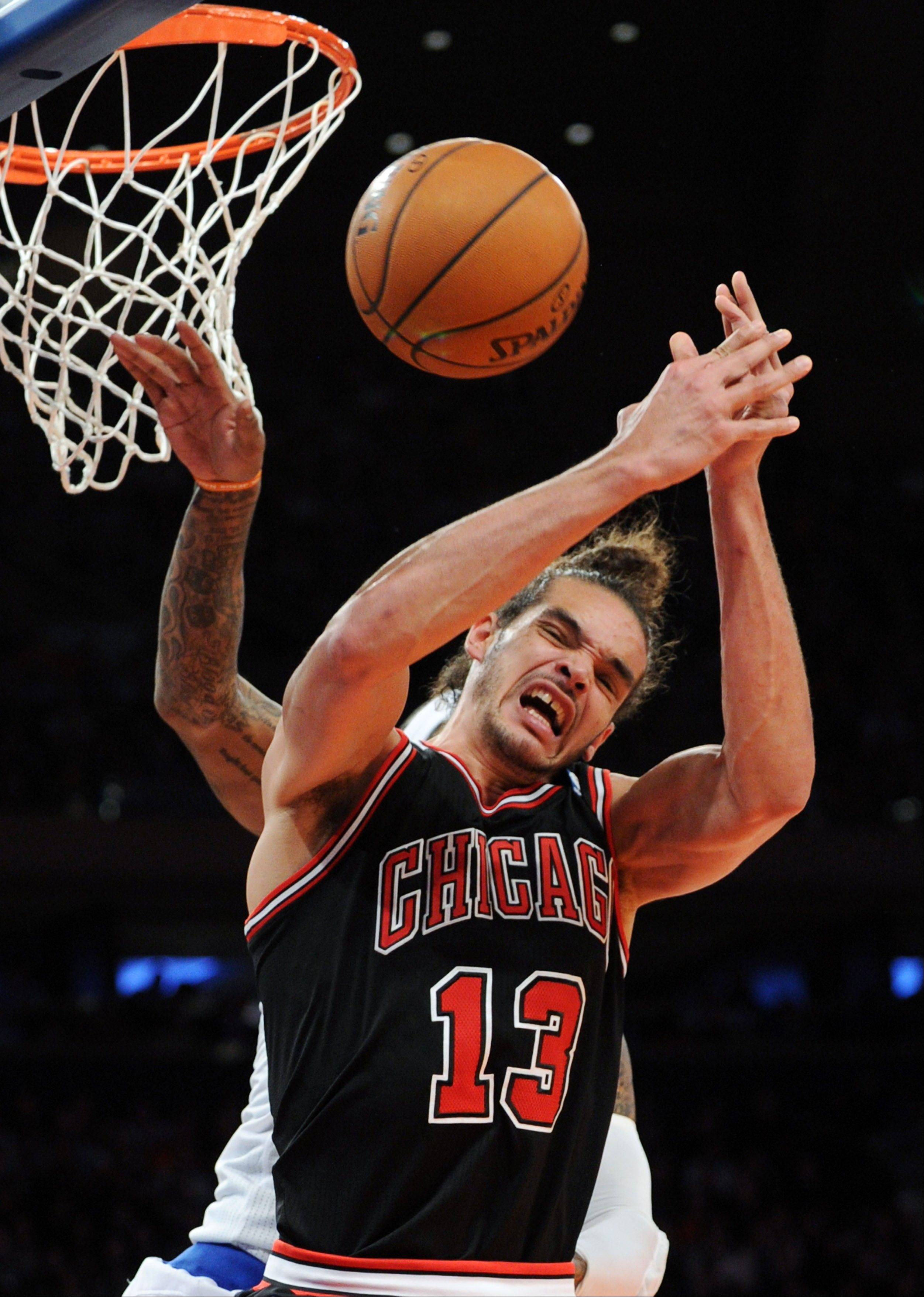 Chicago Bulls' Joakim Noah loses the ball as New York Knicks' J.R. Smith, rear, swats it away during the third quarter of an NBA basketball game Friday, Jan. 11, 2013, at Madison Square Garden in New York. The Bulls defeated the Knicks 108-101.