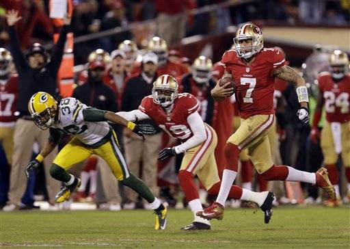 Colin Kaepernick ran for a quarterback playoff record 181 yards and two touchdowns and threw two scoring passes to Michael Crabtree in leading the San Francisco 49ers back to the NFC championship game with a 45-31 victory against the Green Bay Packers on Saturday night.