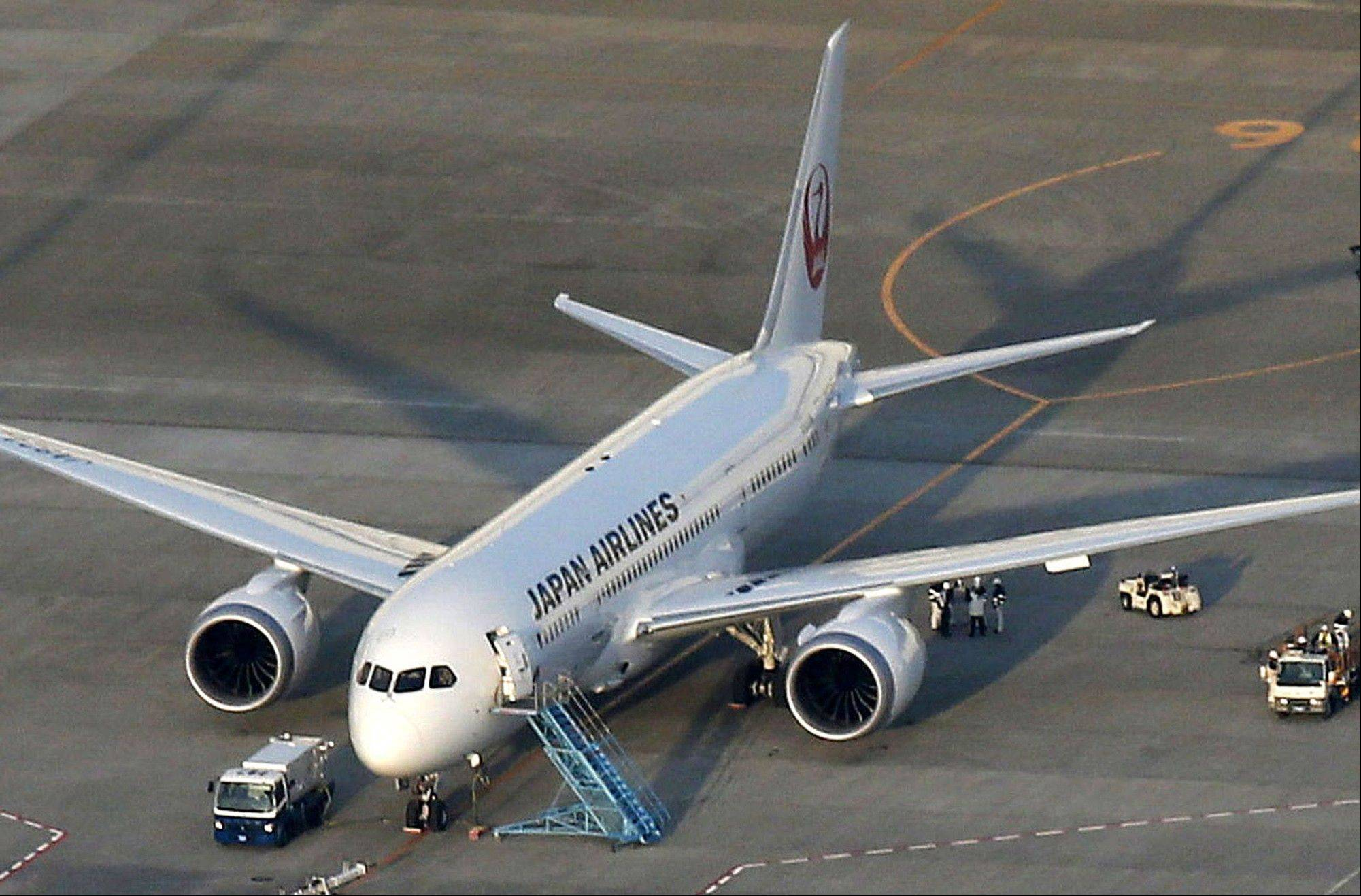 A Japan Airlines 787, from which fuel spilled at Boston's Logan International Airport last Tuesday, sits on the tarmac at Narita Airport in Narita, east of Tokyo, Sunday. Narita airport officials said JAL reported a 100-liter fuel leak from a filler on the 787 during inspection following recent spate of problems.