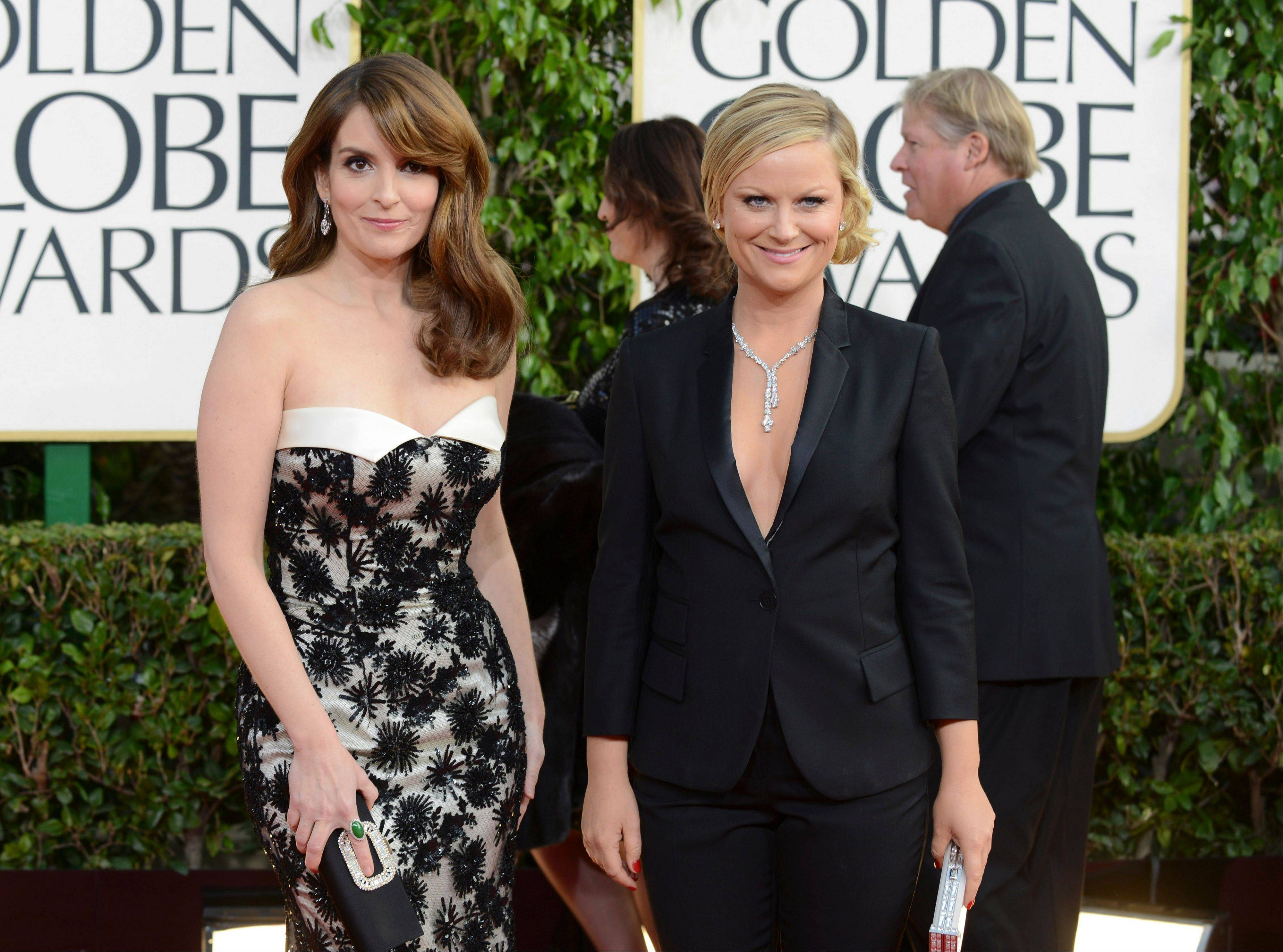 Show hosts Tina Fey, left, and Amy Poehler arrive at the 70th Annual Golden Globe Awards at the Beverly Hilton Hotel on Sunday Jan. 13, 2013, in Beverly Hills, Calif.