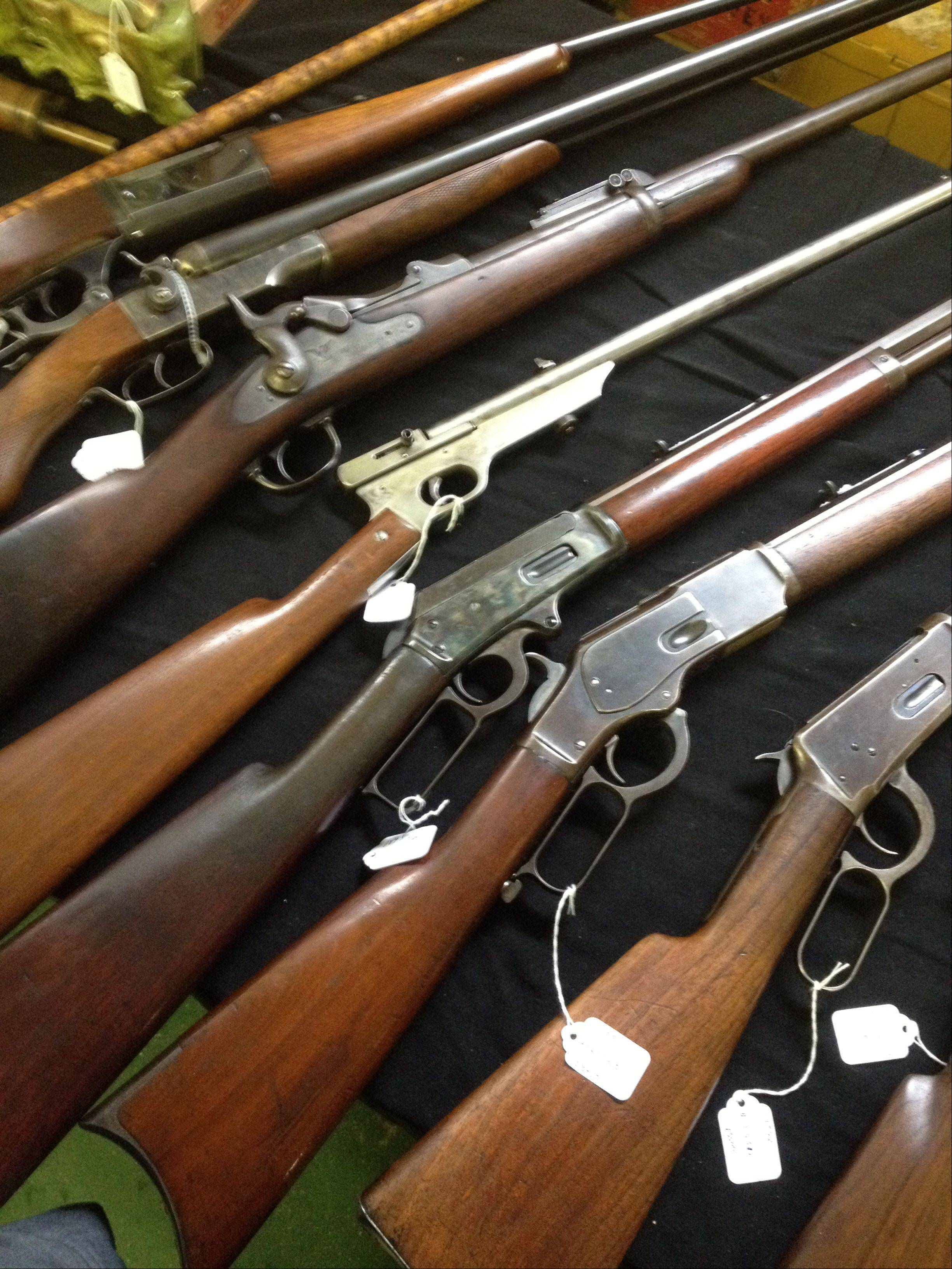 Ammunition and semiautomatic weapons went fast at the Kane County Sportsman's Show at the Kane County Fairgrounds Sunday, which also featured antique rifles, like those pictured here.