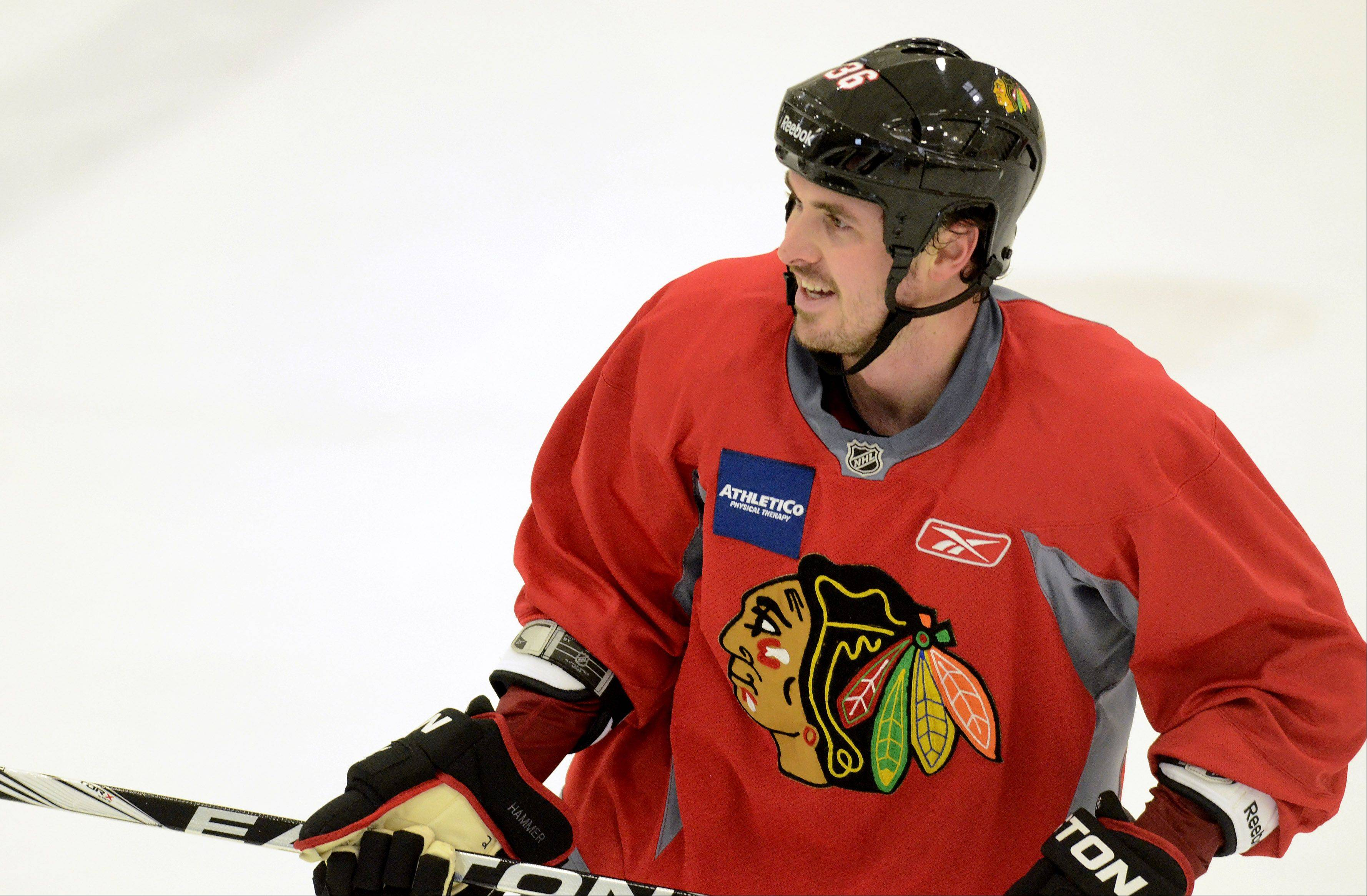 Dave Bolland found himself centering the second line with Patrick Kane and Patrick Sharp when Blackhawks camp opened Sunday.