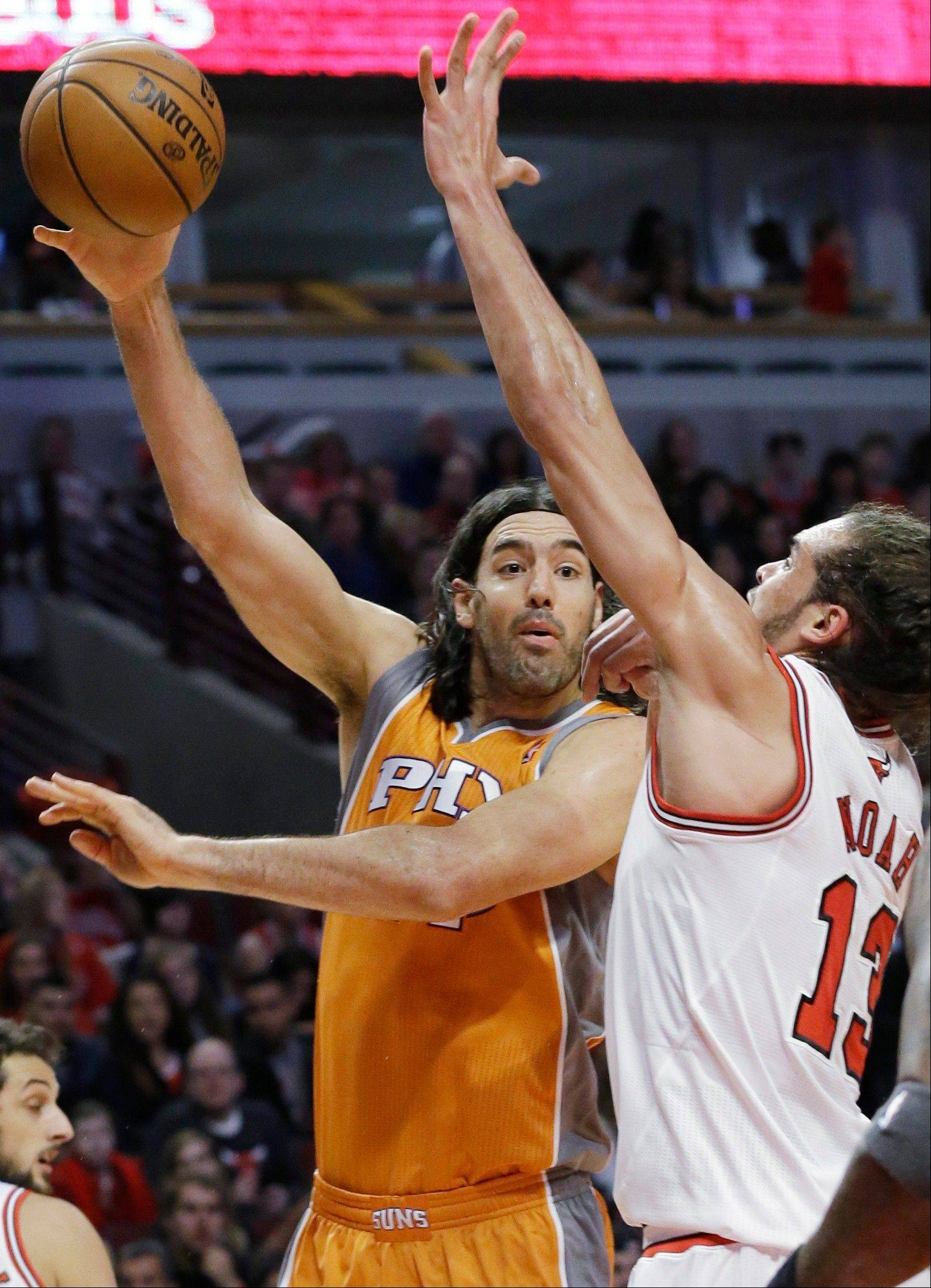 Suns forward Luis Scola passes the ball around Bulls center Joakim Noah during Saturday night's Bulls loss.