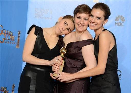 "The cast of ""Girls"" celebrate backstage with Lena Dunham after her win for best actress in a comedy series"