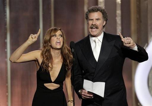 Presenters Kristen Wiig and Will Ferrell have a little fun.