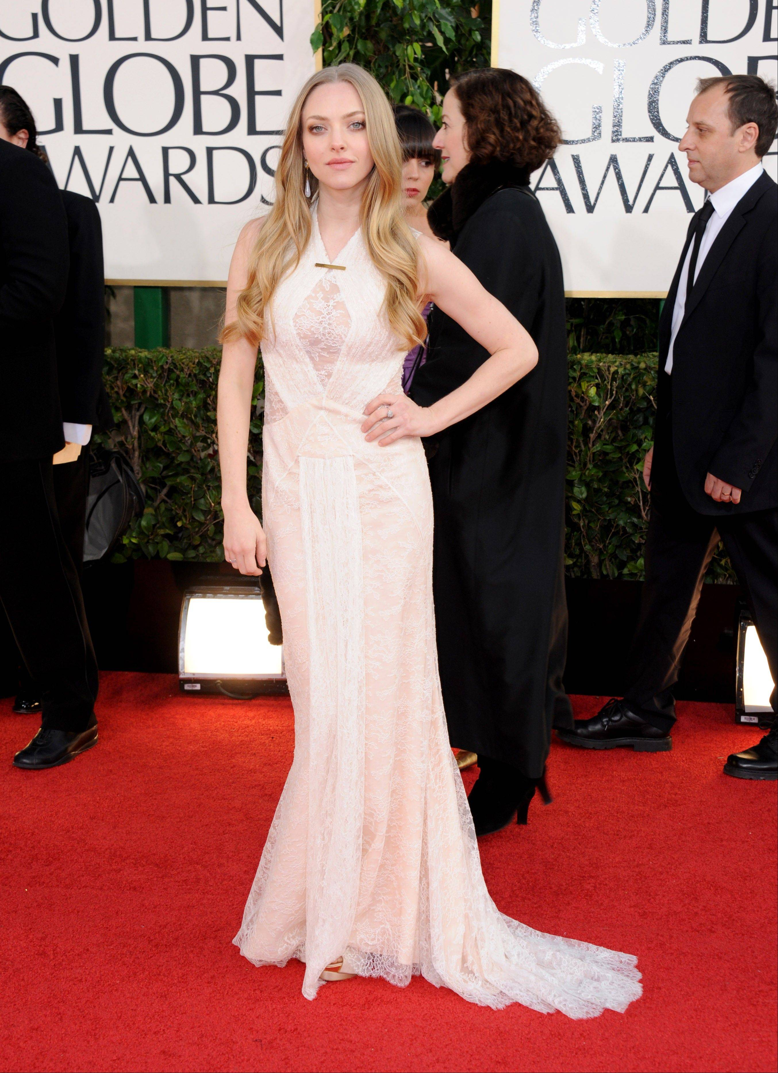 Actress Amanda Seyfried arrives at the 70th Annual Golden Globe Awards at the Beverly Hilton Hotel on Sunday Jan. 13, 2013, in Beverly Hills, Calif.