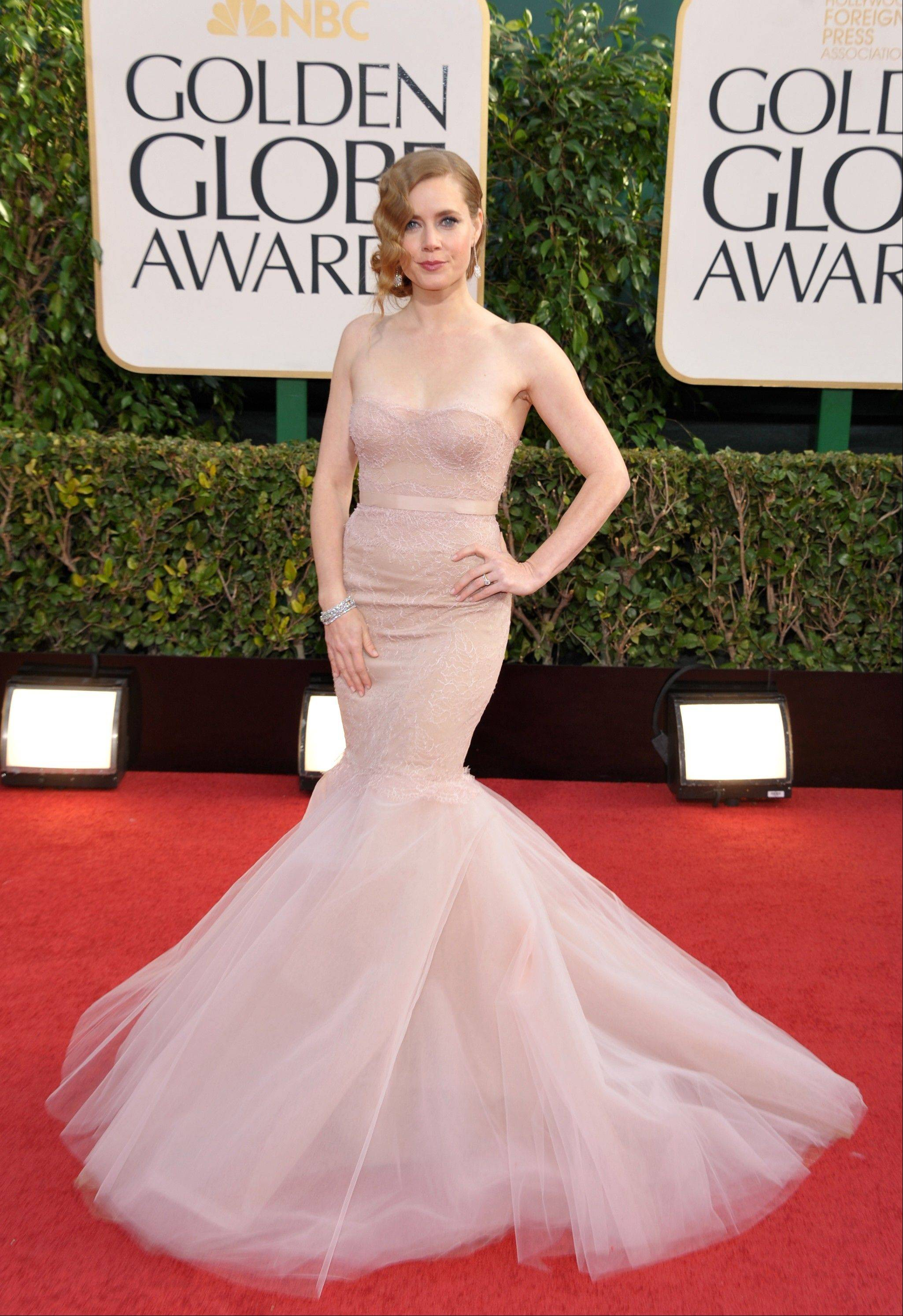 Amy Adams arrives at the 70th Annual Golden Globe Awards at the Beverly Hilton Hotel on Sunday Jan. 13, 2013, in Beverly Hills, Calif.