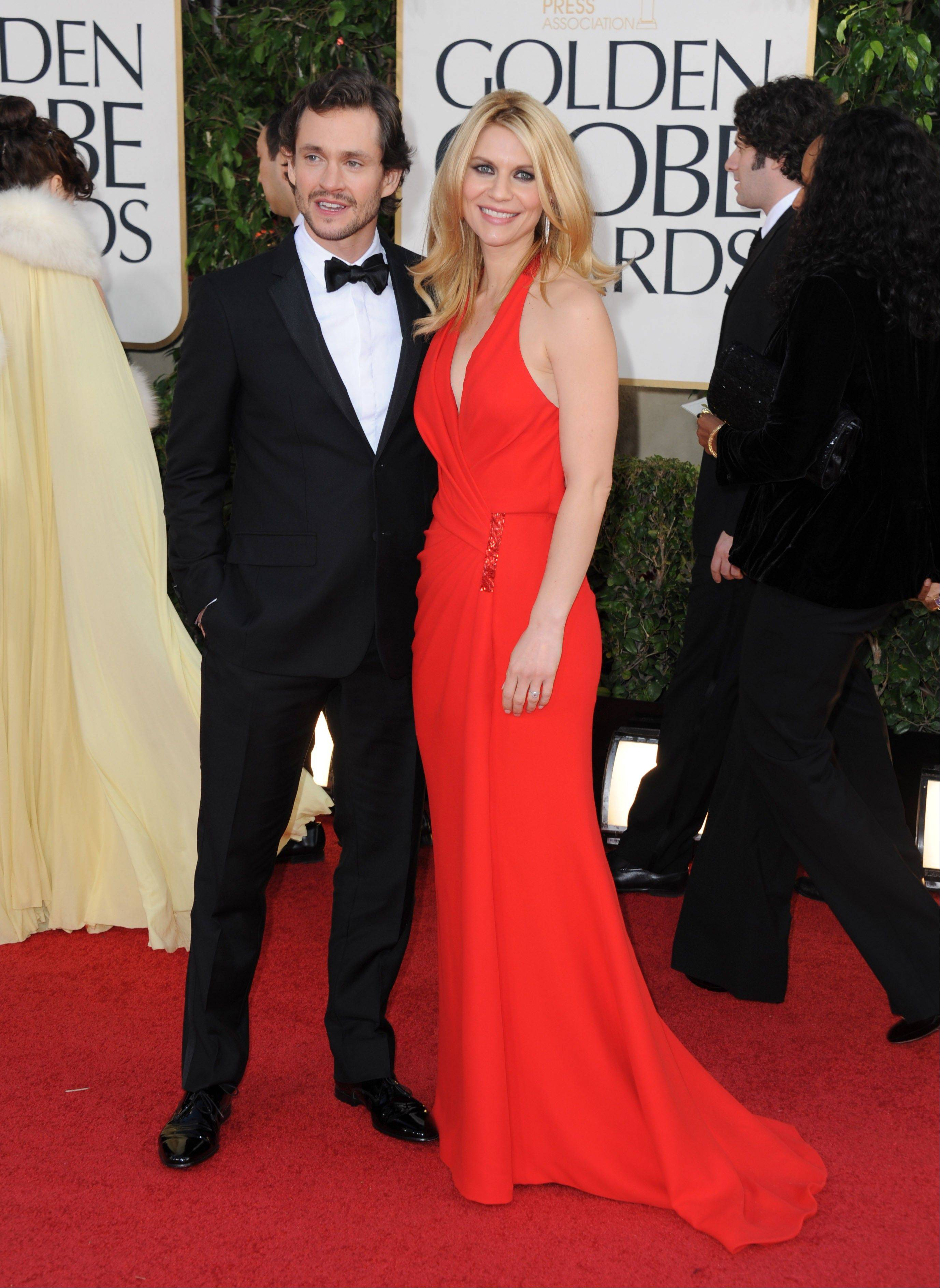 """Homeland"" actress Claire Danes and her husband, actor Hugh Dancy, arrive at the 70th Annual Golden Globe Awards at the Beverly Hilton Hotel on Sunday Jan. 13, 2013, in Beverly Hills, Calif."