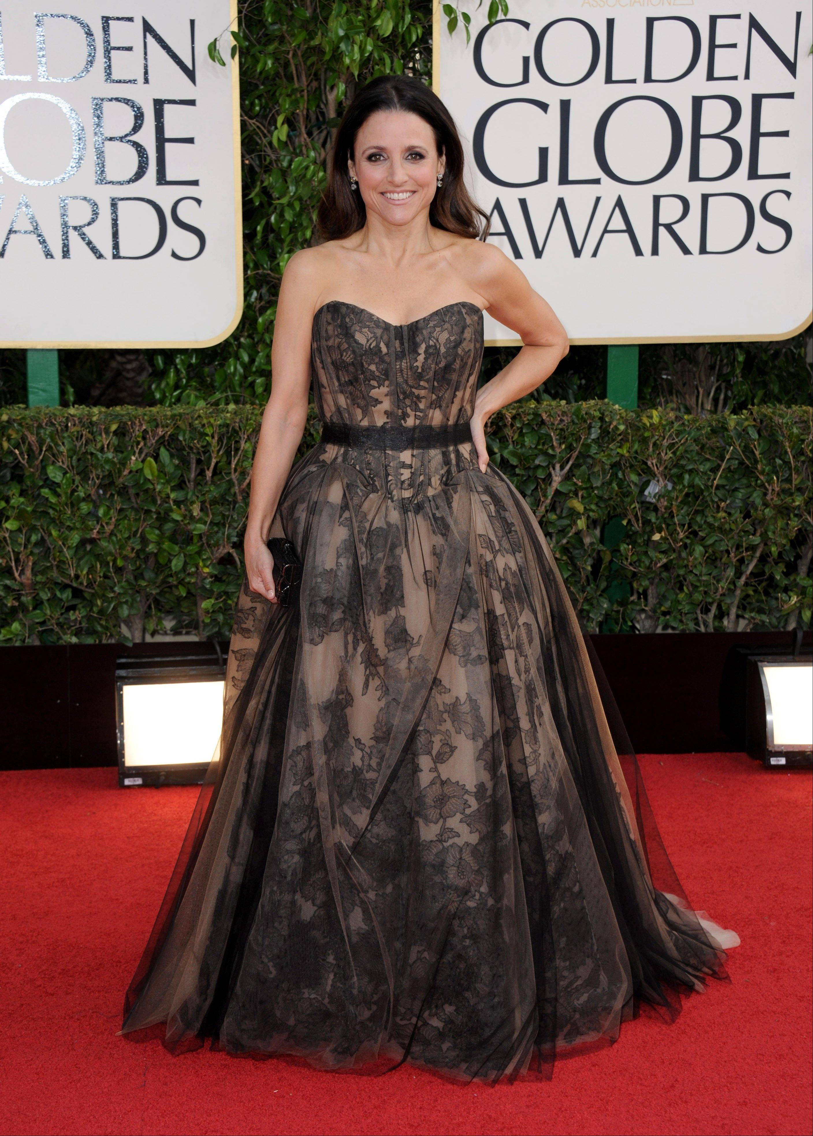 Actress Julia Louis-Dreyfus arrives at the 70th Annual Golden Globe Awards at the Beverly Hilton Hotel on Sunday Jan. 13, 2013, in Beverly Hills, Calif.