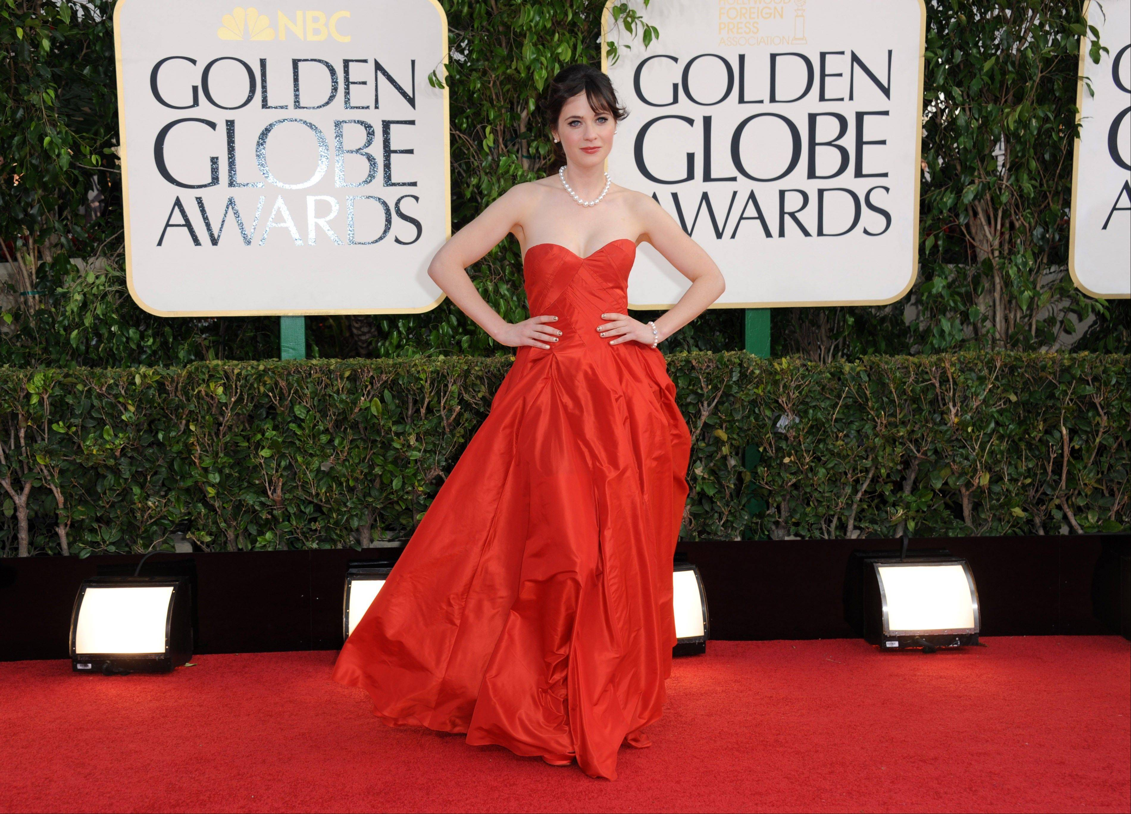 Actress Zooey Deschanel arrives at the 70th Annual Golden Globe Awards at the Beverly Hilton Hotel on Sunday Jan. 13, 2013, in Beverly Hills, Calif.