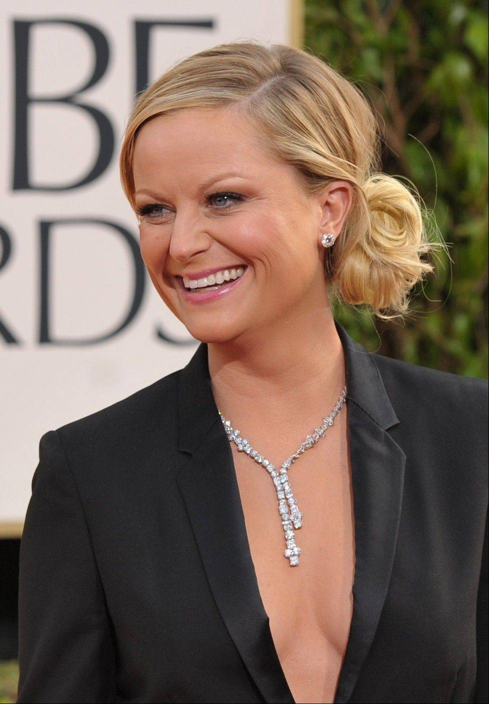 Amy Poehler arrives at the 70th Annual Golden Globe Awards at the Beverly Hilton Hotel on Sunday Jan. 13, 2013, in Beverly Hills, Calif.