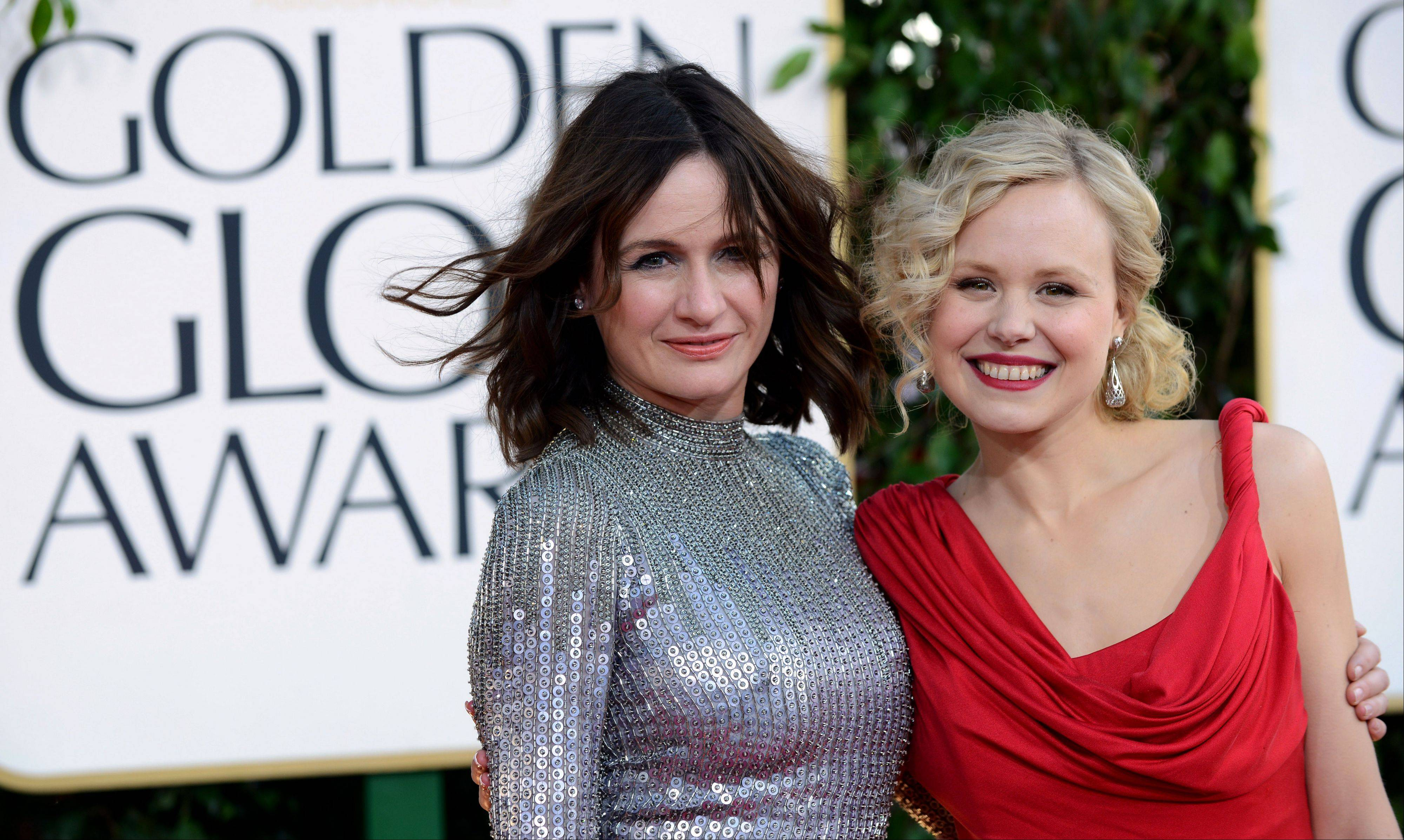 """Newsroom"" actresses Emily Mortimer, left, and Alison Pill arrive at the 70th Annual Golden Globe Awards at the Beverly Hilton Hotel on Sunday Jan. 13, 2013, in Beverly Hills, Calif."