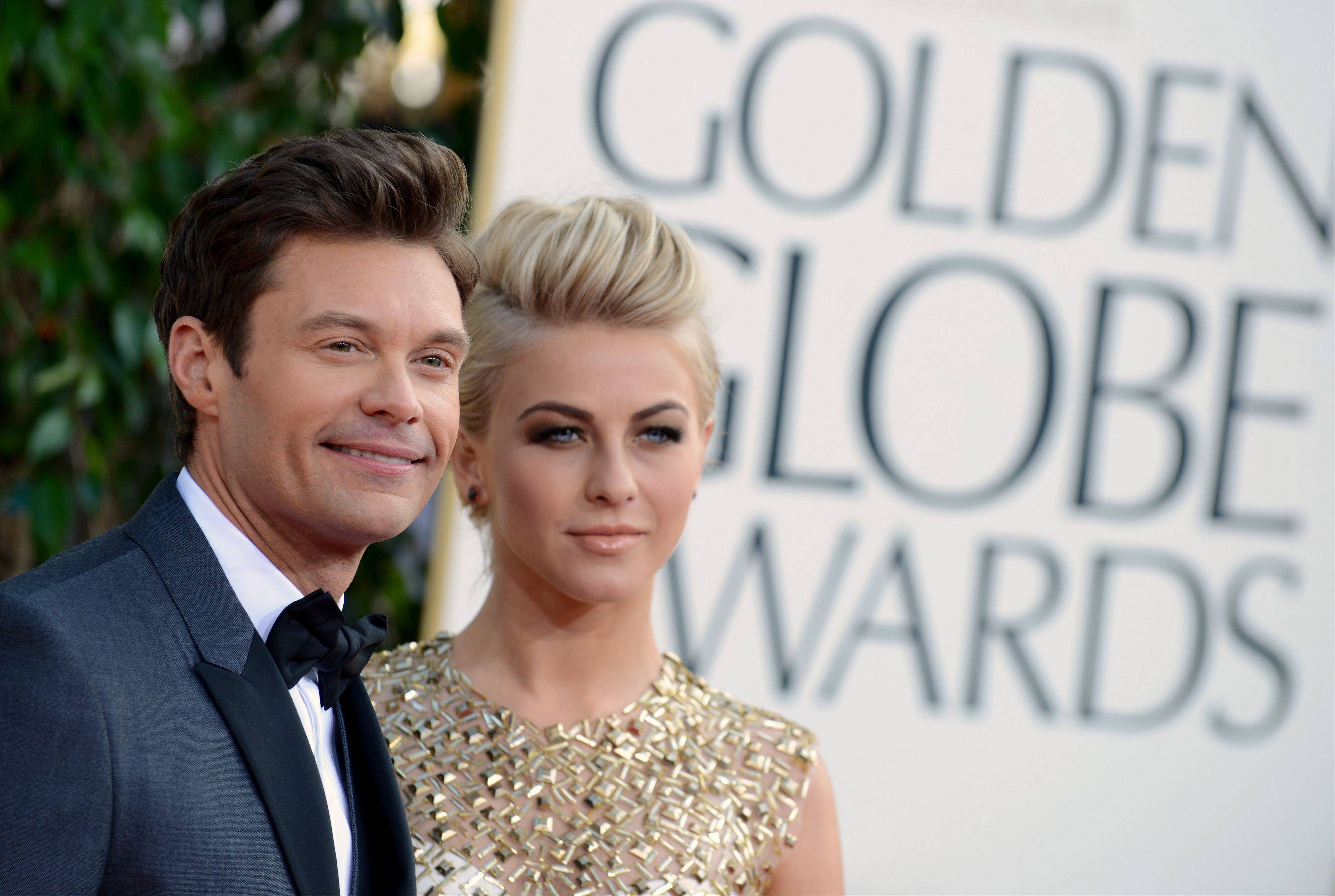 TV host Ryan Seacrest and actress Julianne Hough arrive at the 70th Annual Golden Globe Awards at the Beverly Hilton Hotel on Sunday Jan. 13, 2013, in Beverly Hills, Calif.