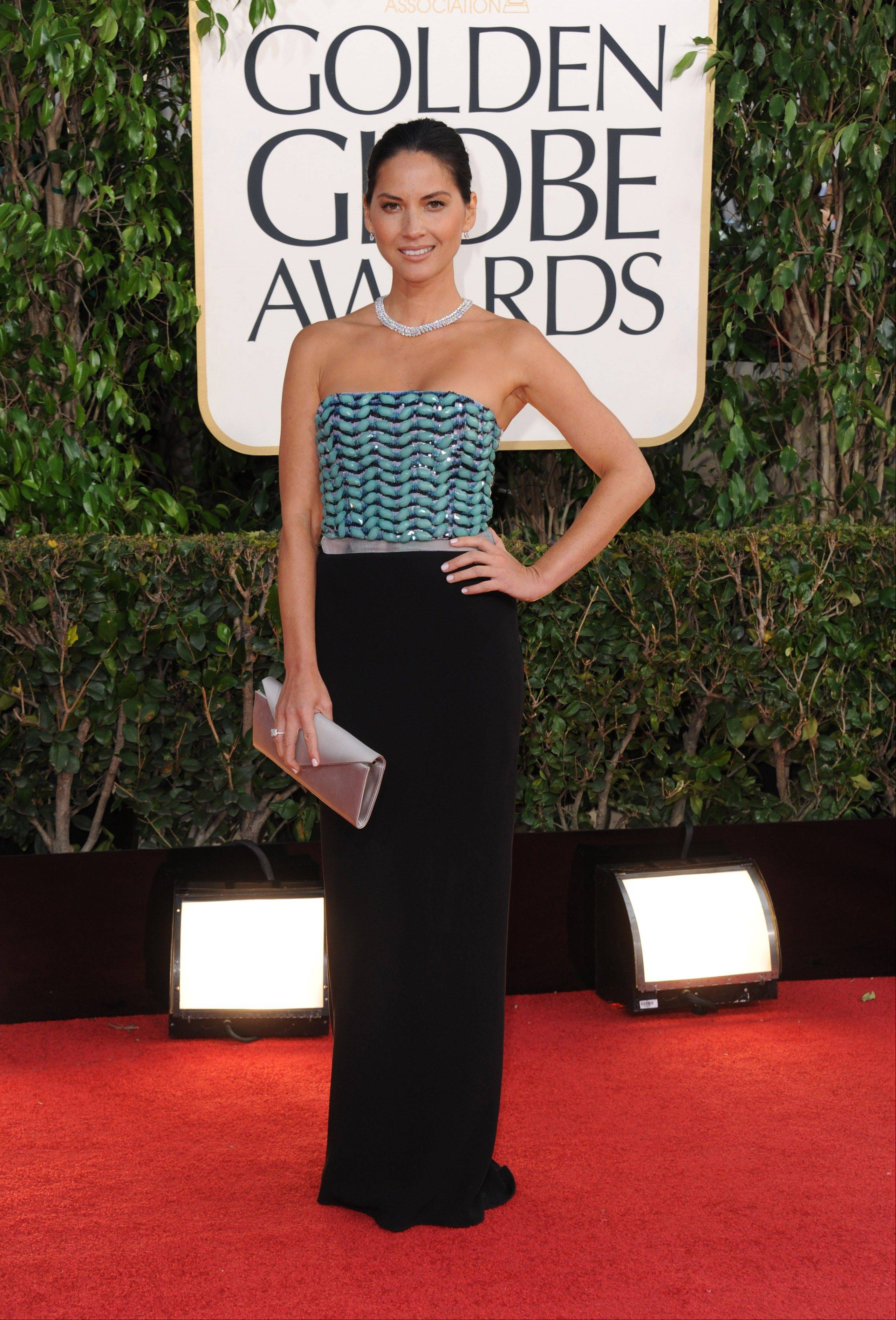 Actress Olivia Munn arrives at the 70th Annual Golden Globe Awards at the Beverly Hilton Hotel on Sunday Jan. 13, 2013, in Beverly Hills, Calif.