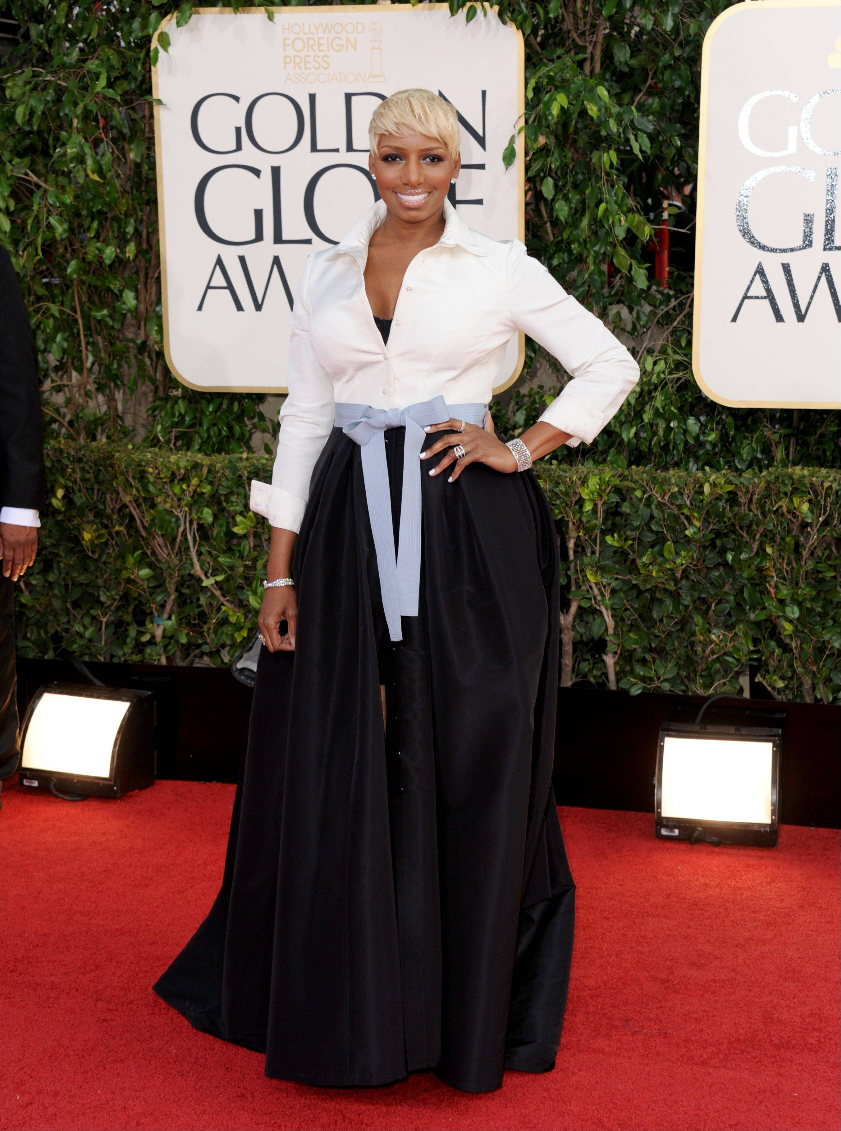 Actress and TV personality NeNe Leakes arrives at the 70th Annual Golden Globe Awards at the Beverly Hilton Hotel on Sunday Jan. 13, 2013, in Beverly Hills, Calif.
