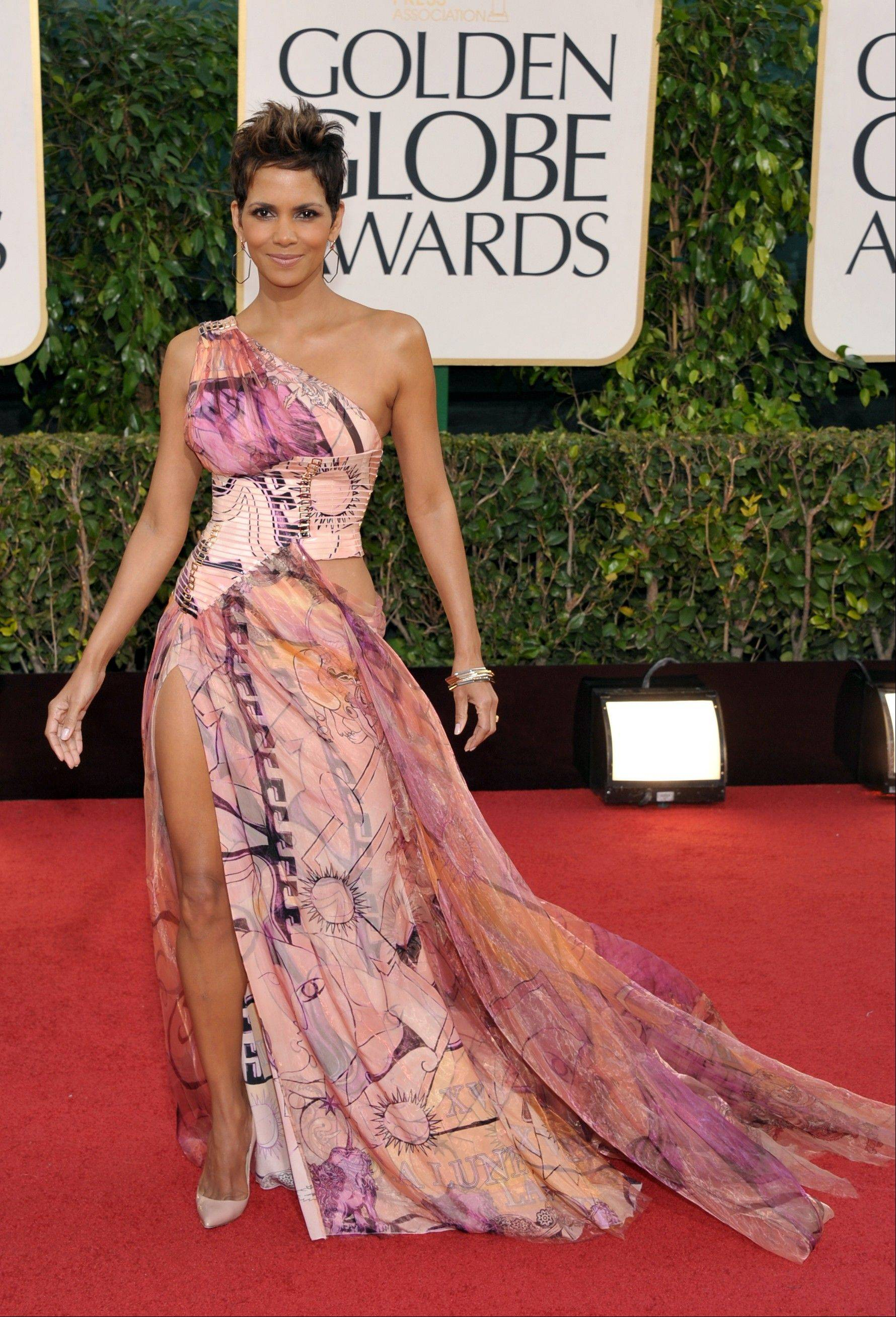 Actress Halle Berry arrives at the 70th Annual Golden Globe Awards at the Beverly Hilton Hotel on Sunday Jan. 13, 2013, in Beverly Hills, Calif.