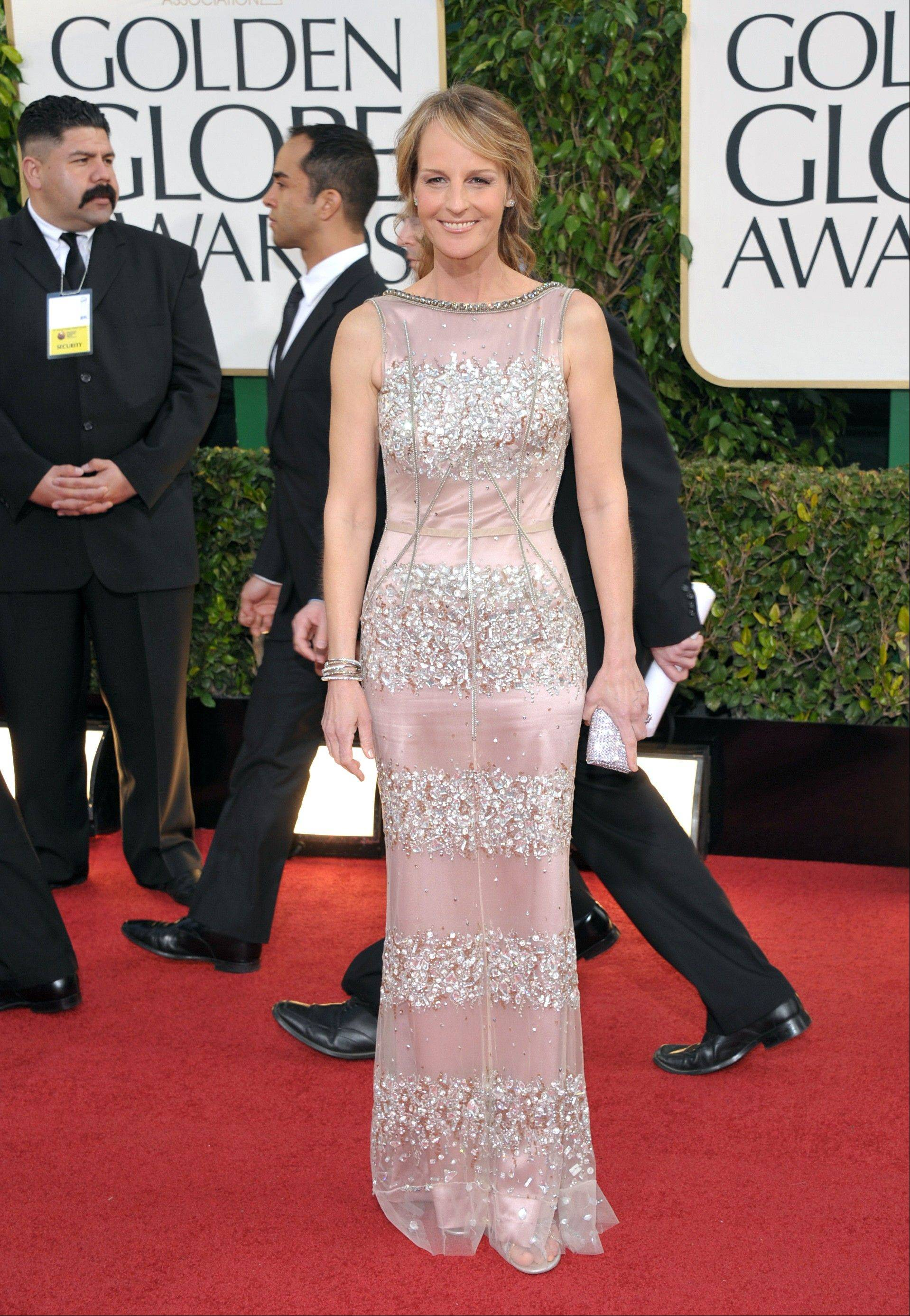 Actress Helen Hunt arrives at the 70th Annual Golden Globe Awards at the Beverly Hilton Hotel on Sunday Jan. 13, 2013, in Beverly Hills, Calif.