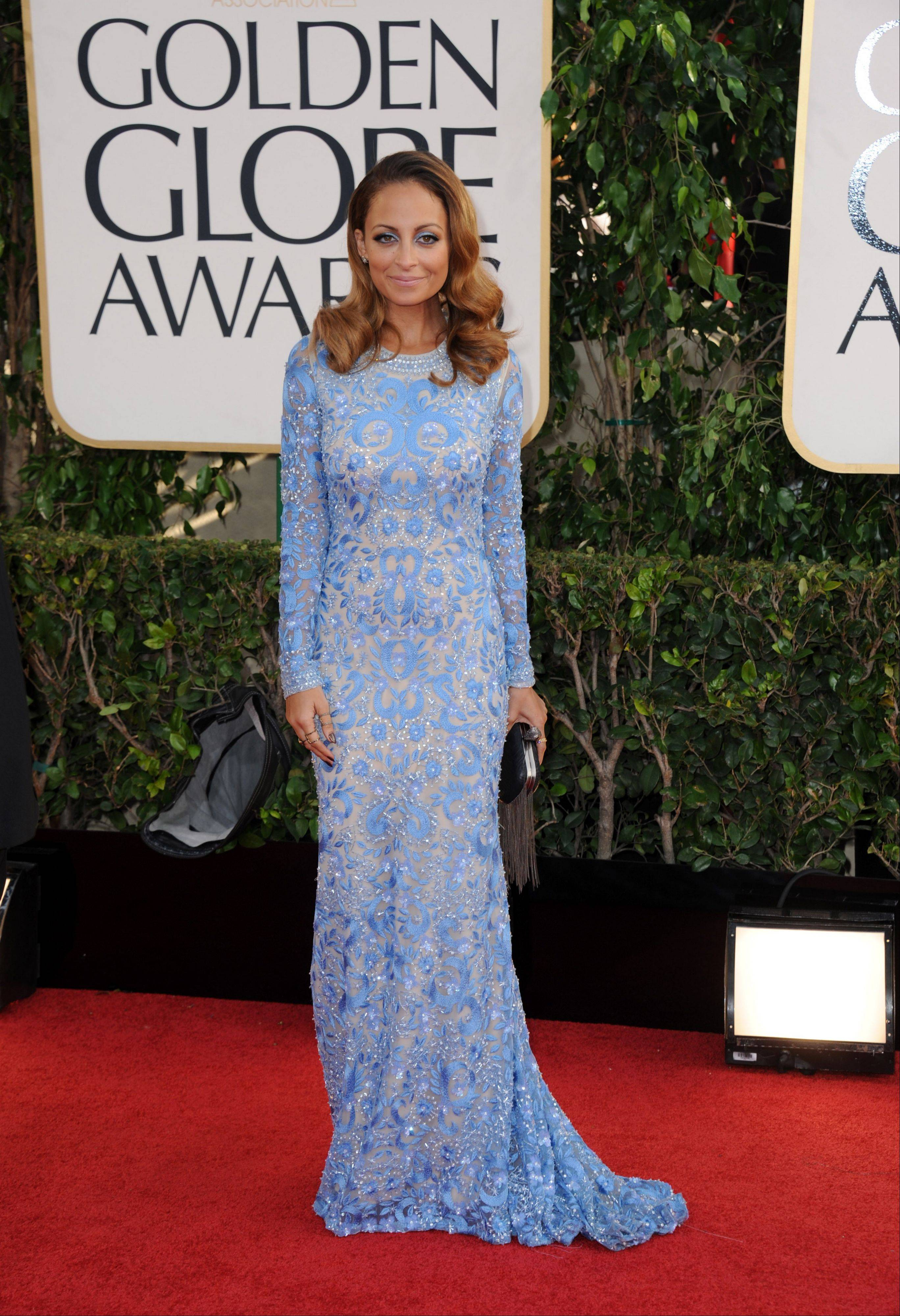 Designer Nicole Richie arrives at the 70th Annual Golden Globe Awards at the Beverly Hilton Hotel on Sunday Jan. 13, 2013, in Beverly Hills, Calif.