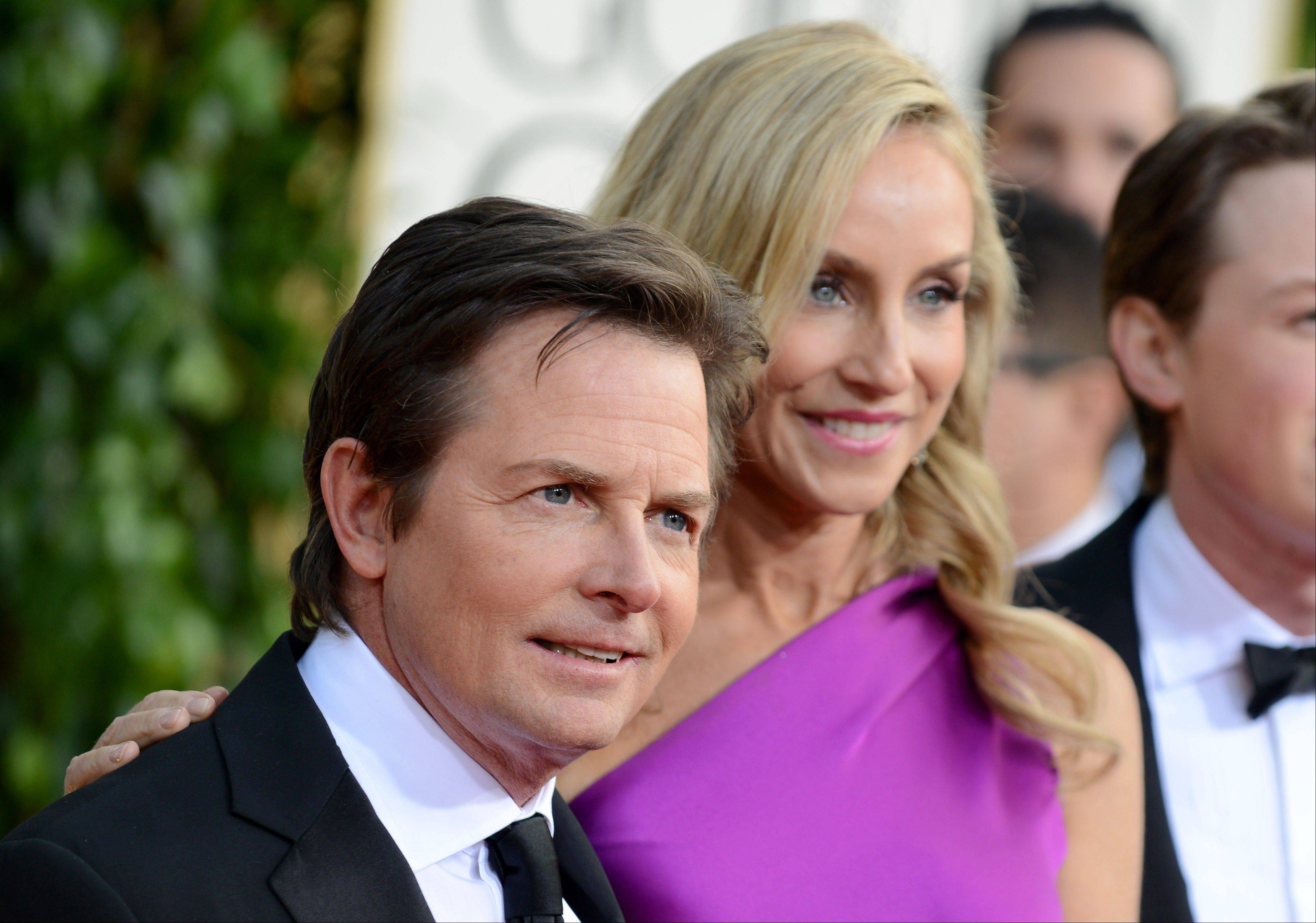 Actor Michael J. Fox and Tracy Pollan arrive at the 70th Annual Golden Globe Awards at the Beverly Hilton Hotel on Sunday Jan. 13, 2013, in Beverly Hills, Calif.