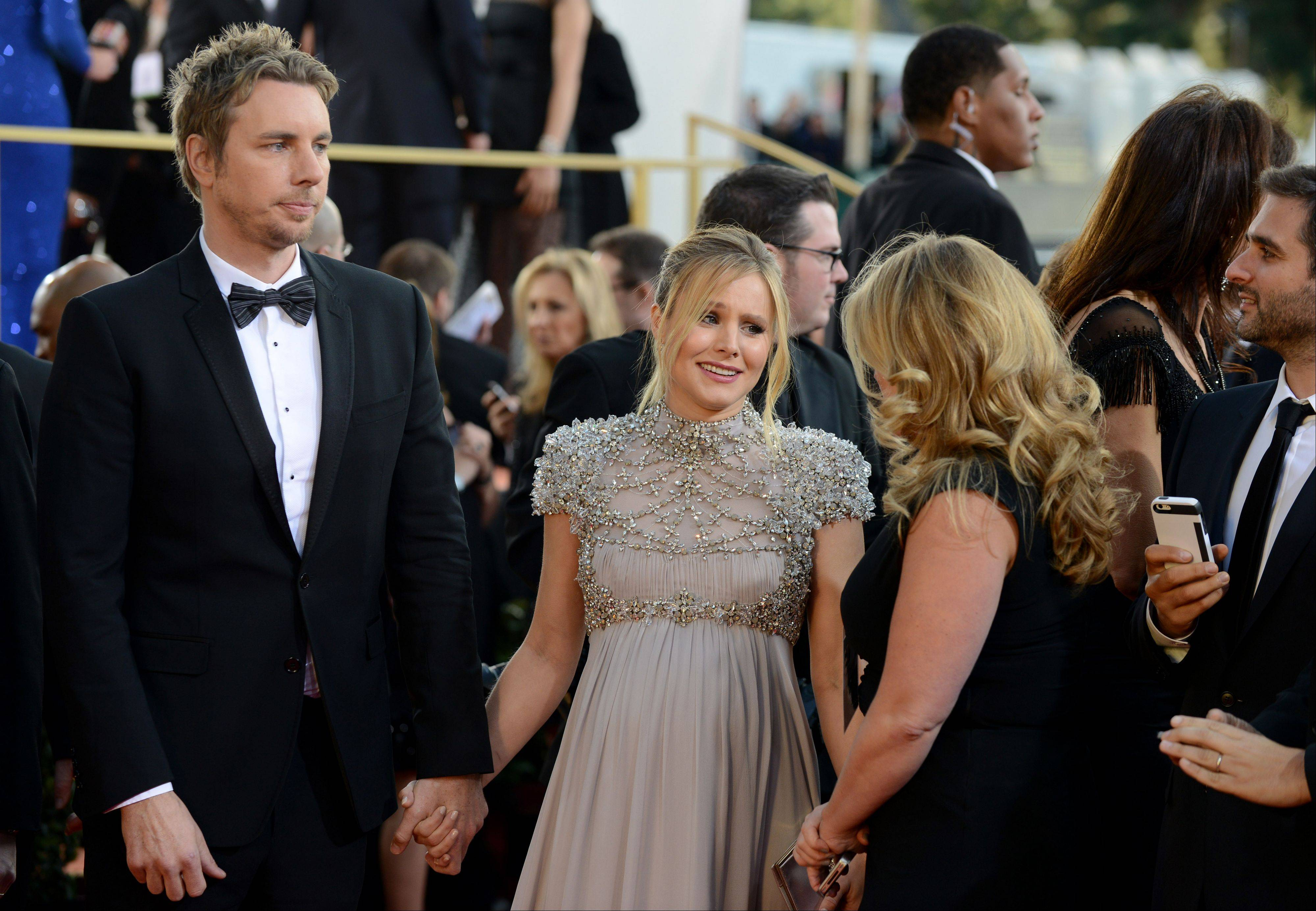 Actors Dax Shepard, left, and Kristen Bell arrive at the 70th Annual Golden Globe Awards at the Beverly Hilton Hotel on Sunday Jan. 13, 2013, in Beverly Hills, Calif.