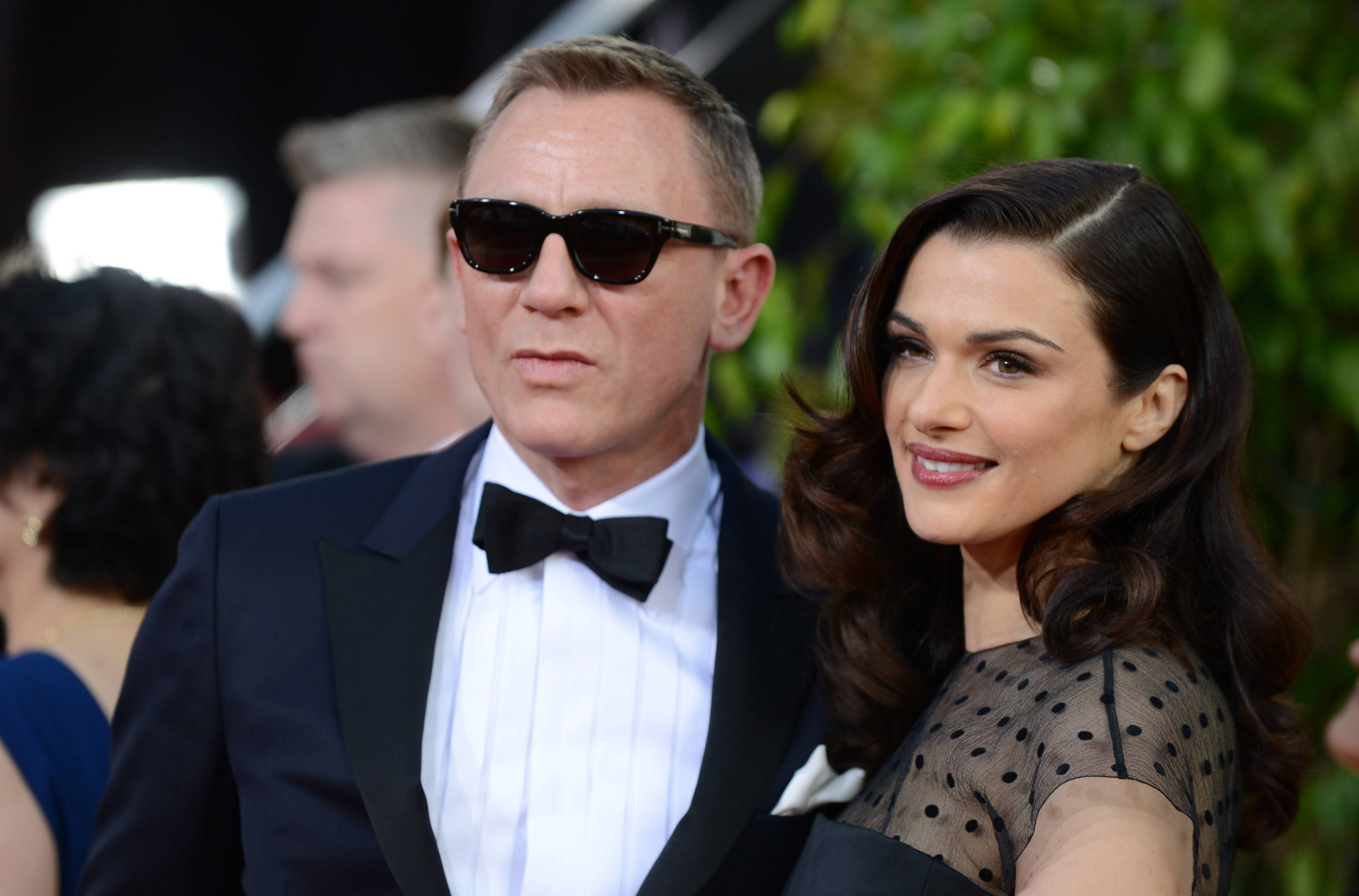 """Skyfall"" star Daniel Craig and his wife, actress Rachel Weisz walk the red carpet Sunday night before the Golden Globes."