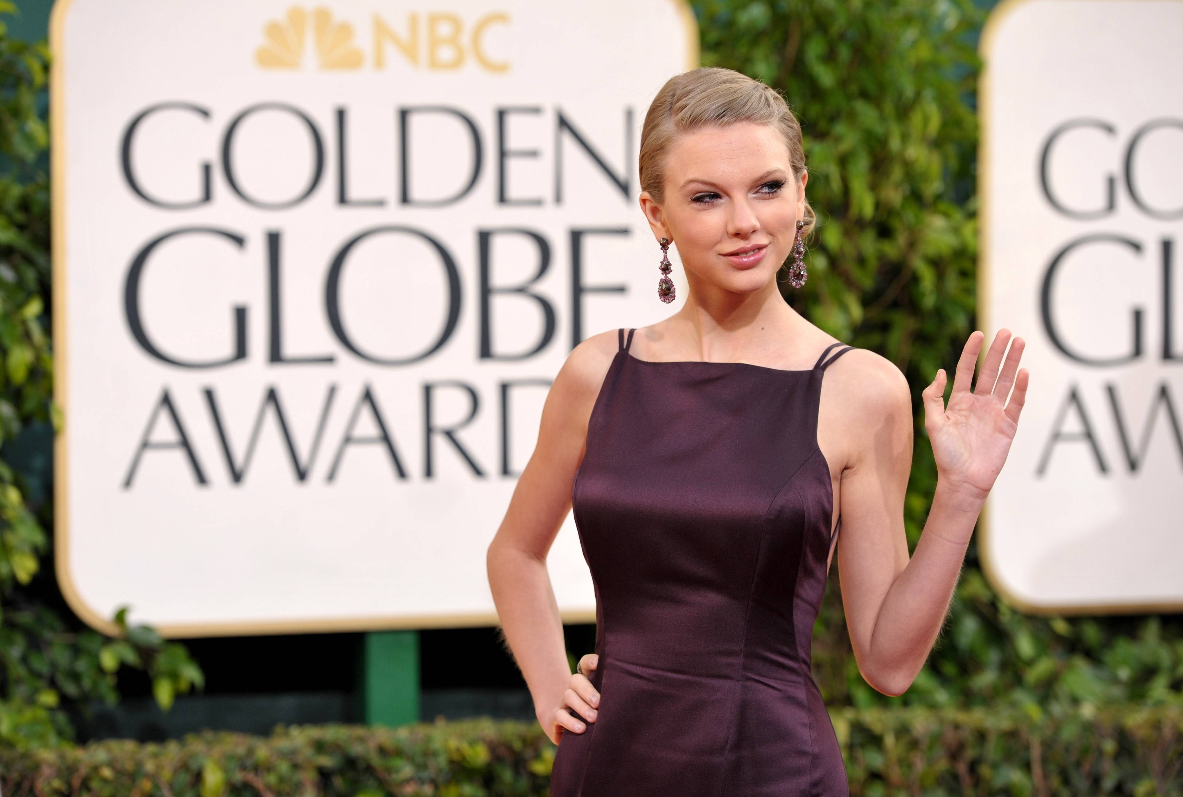 Singer Taylor Swift looks all grown up on the Golden Globes red carpet.