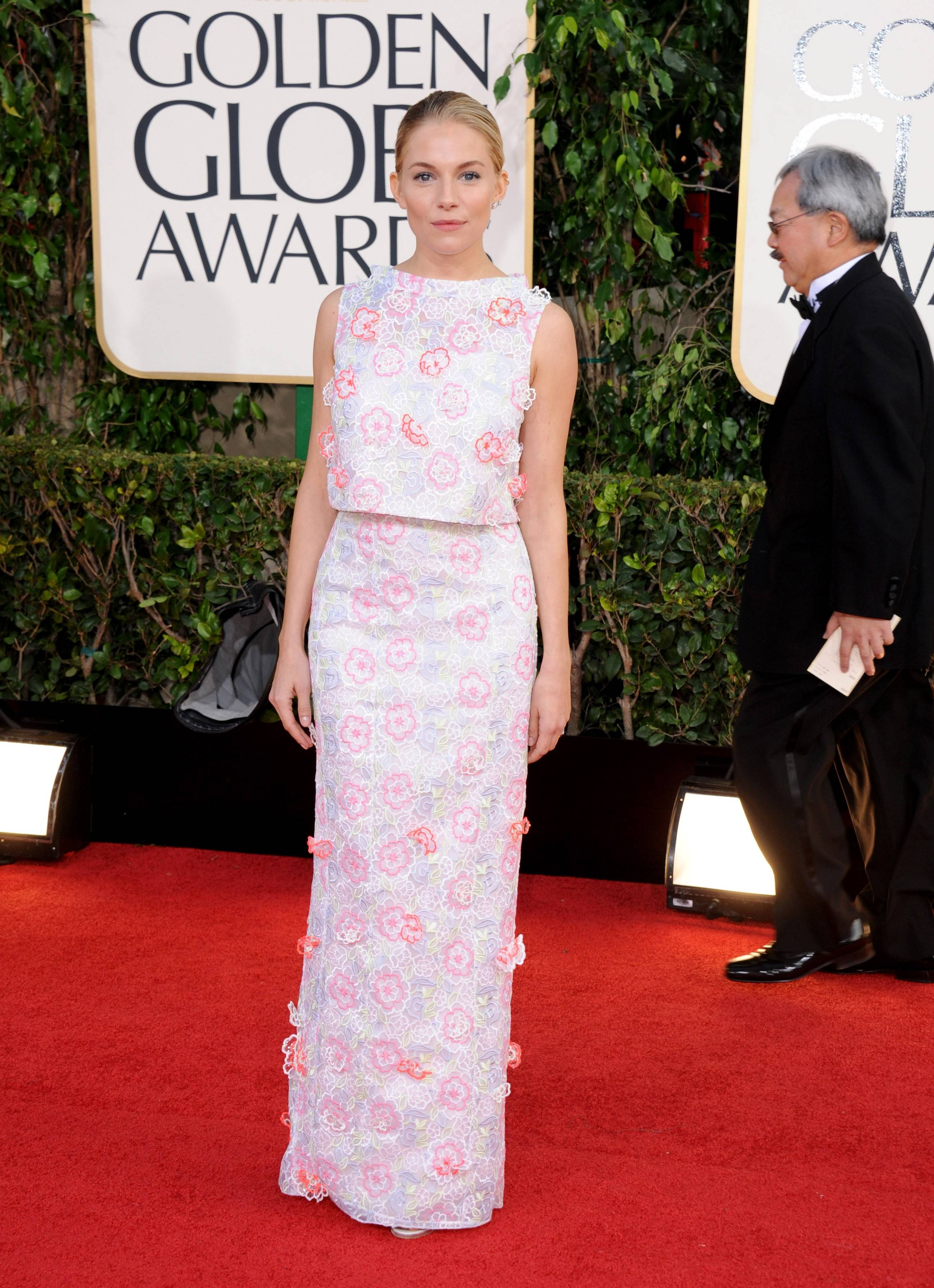 Actress Sienna Miller walks the red carpet Sunday night.