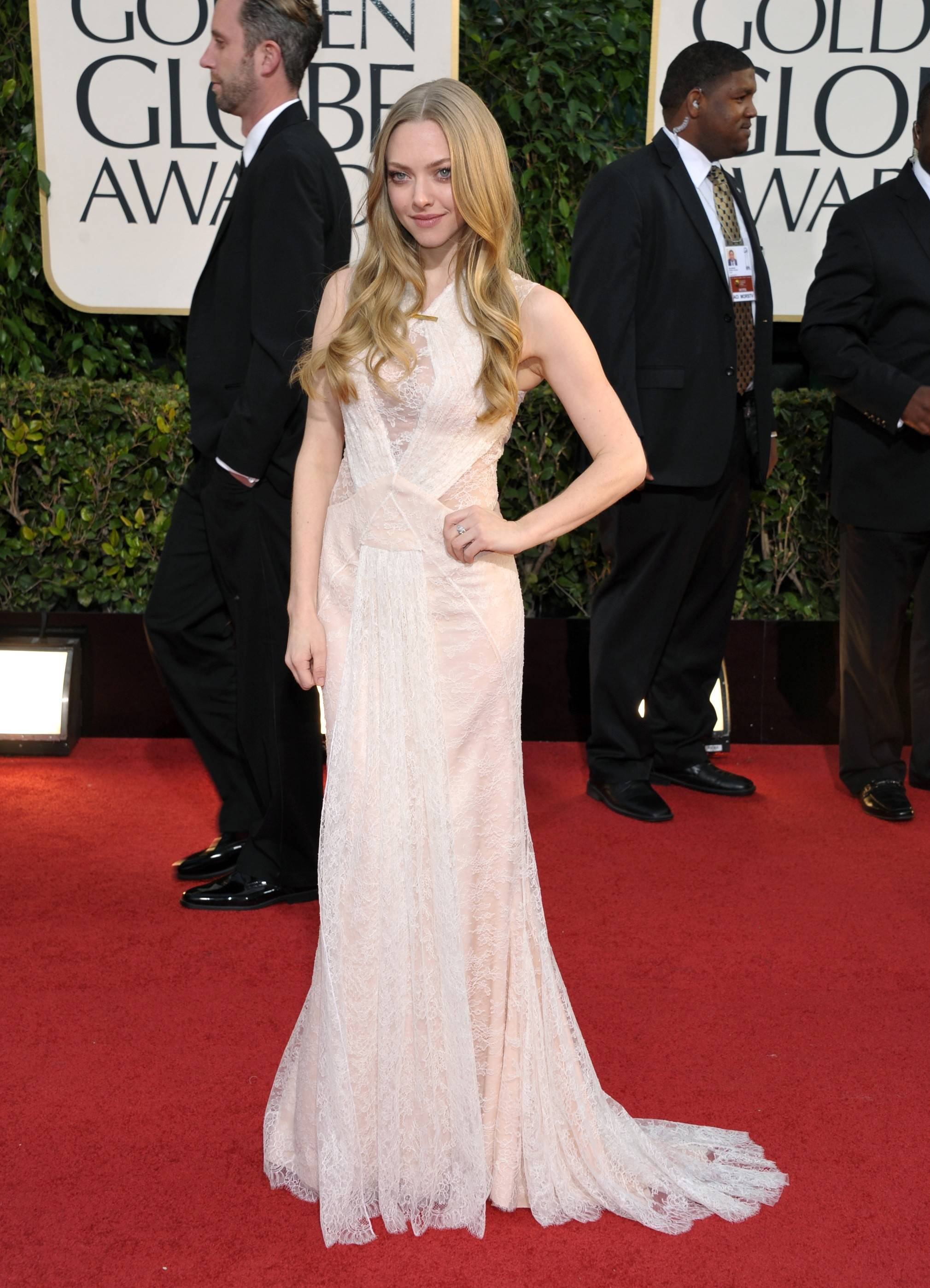 """Les Miserables"" star Amanda Seyfried poses on the red carpet before heading into the ceremony."
