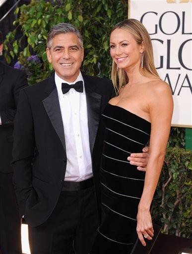 Actor George Clooney walks the red carpet with his girlfriend, Stacey Kiebler