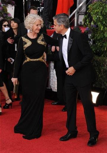 George Clooney takes a moment to chat with actress Helen Mirren