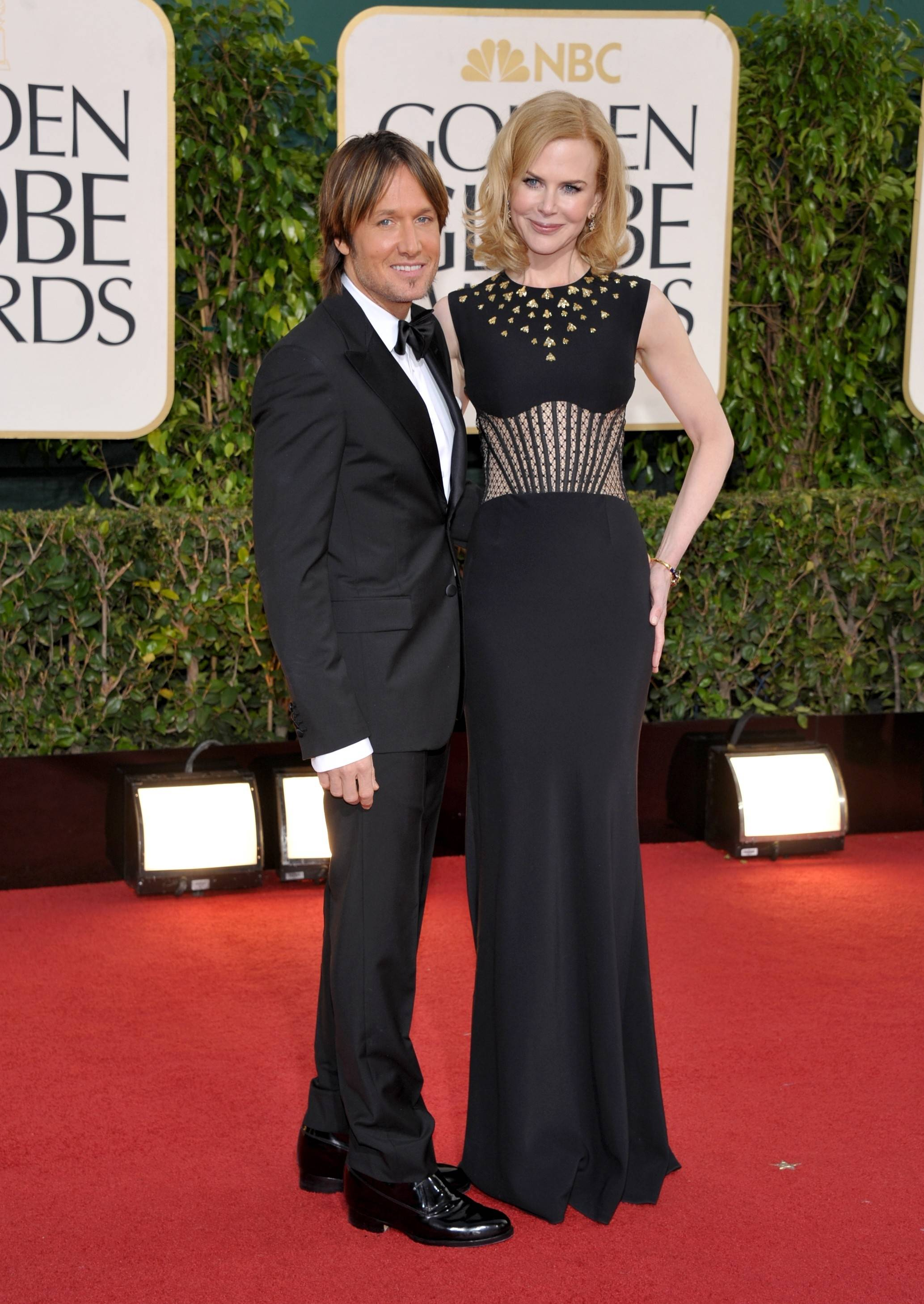 """X Factor"" host Keith Urban and his wife, actress Nicole Kidman, stay close on the red carpet"