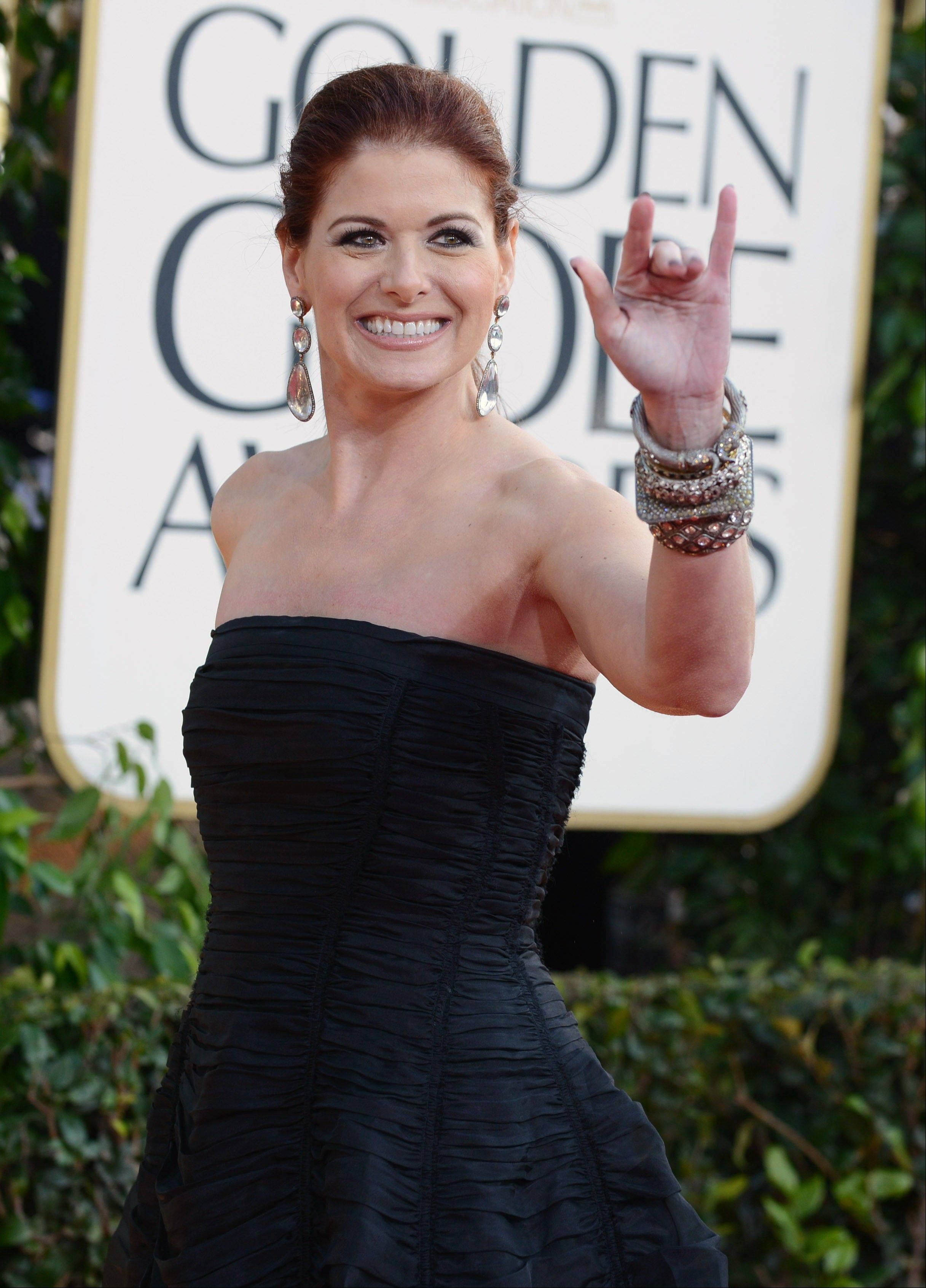 """Smash"" actress Debra Messing arrives at the 70th Annual Golden Globe Awards at the Beverly Hilton Hotel on Sunday Jan. 13, 2013, in Beverly Hills, Calif."