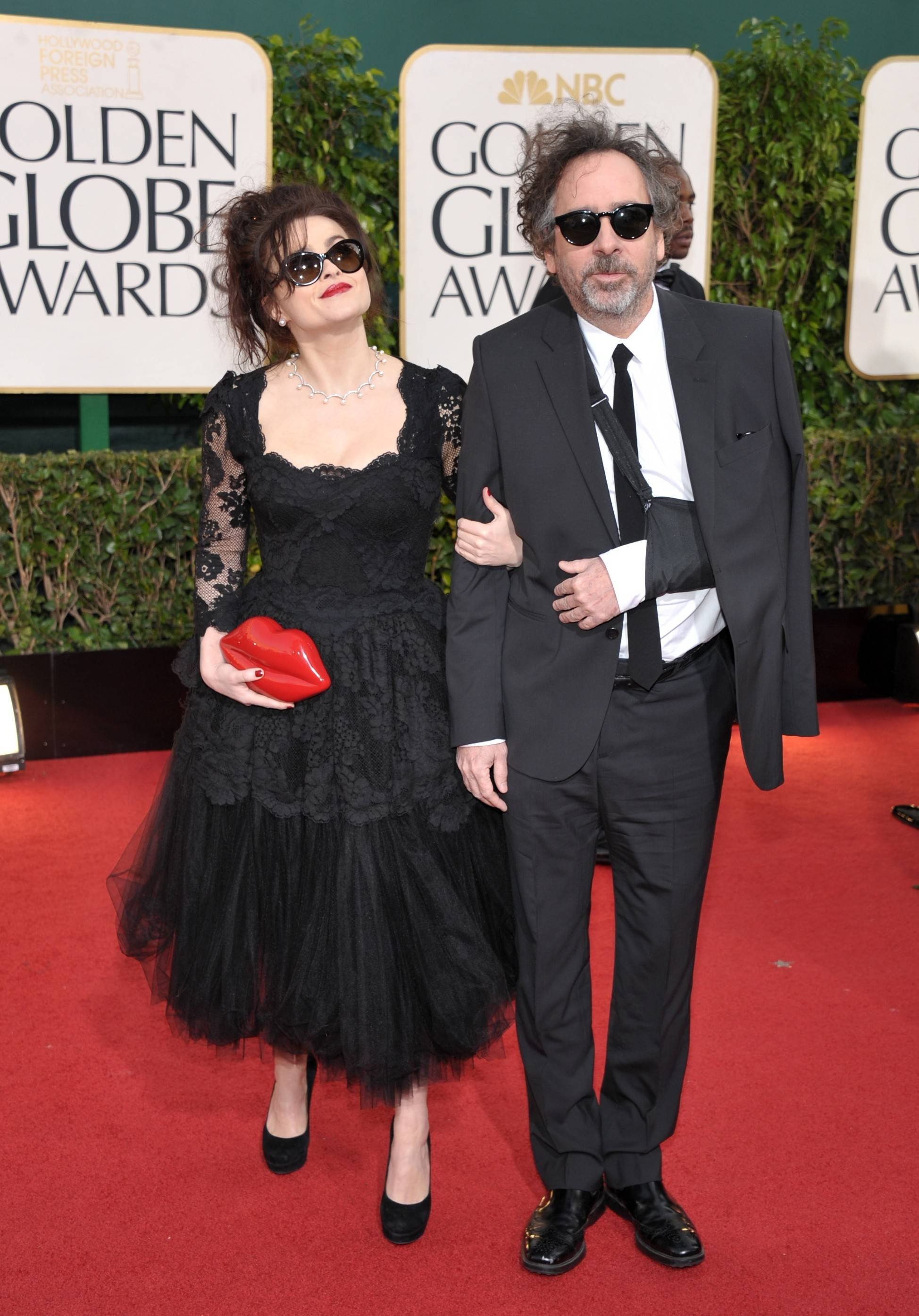 Actress Helena Boham Carter keeps close to her husband, director Tim Burton.