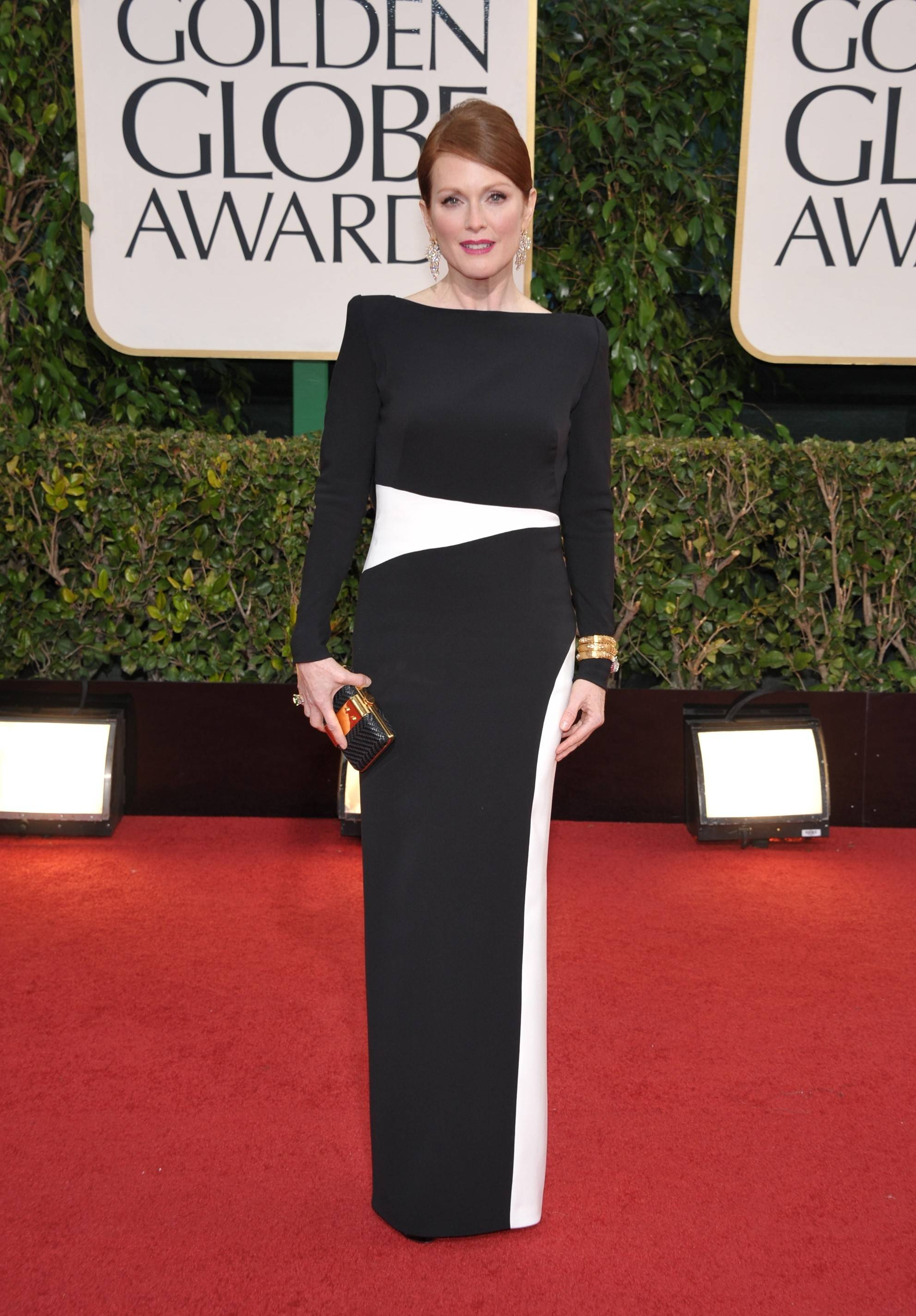 "Julianne Moore, who was up for her role in ""Game Change,"" walks the red carpet."