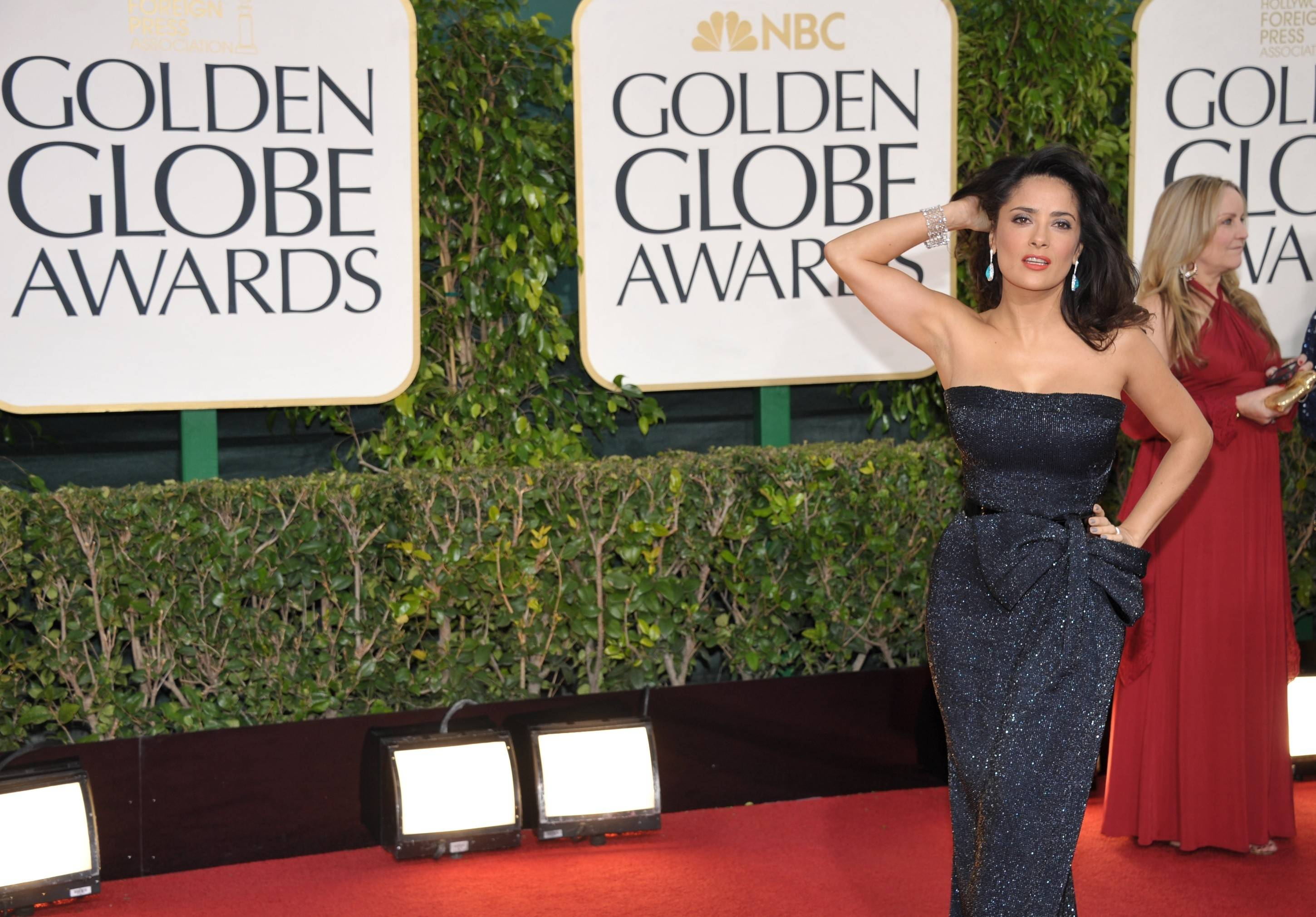 Salma Hayek poses along the red carpet.