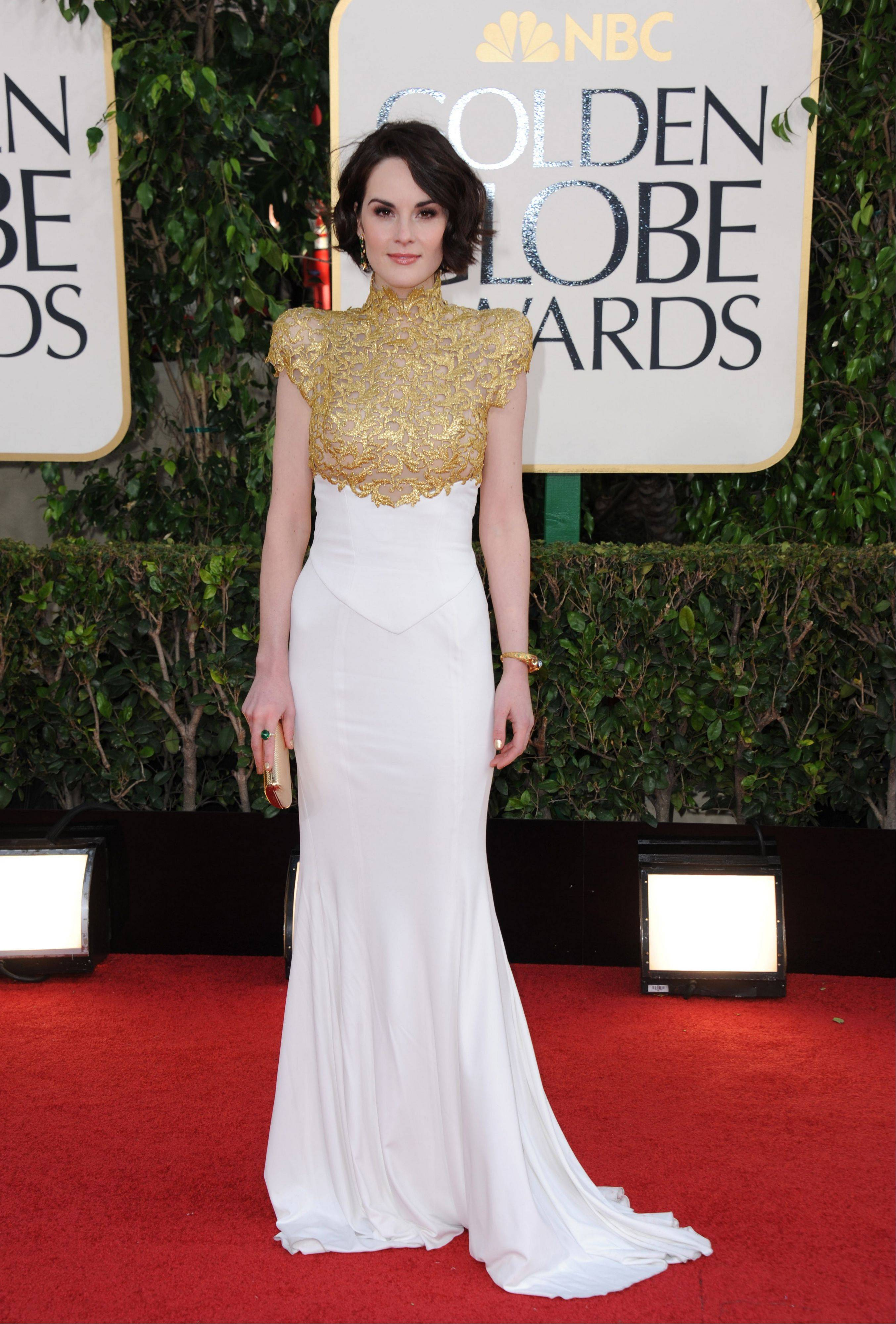 """Downton Abbey"" Actress Michelle Dockery arrives at the 70th Annual Golden Globe Awards at the Beverly Hilton Hotel on Sunday Jan. 13, 2013, in Beverly Hills, Calif."