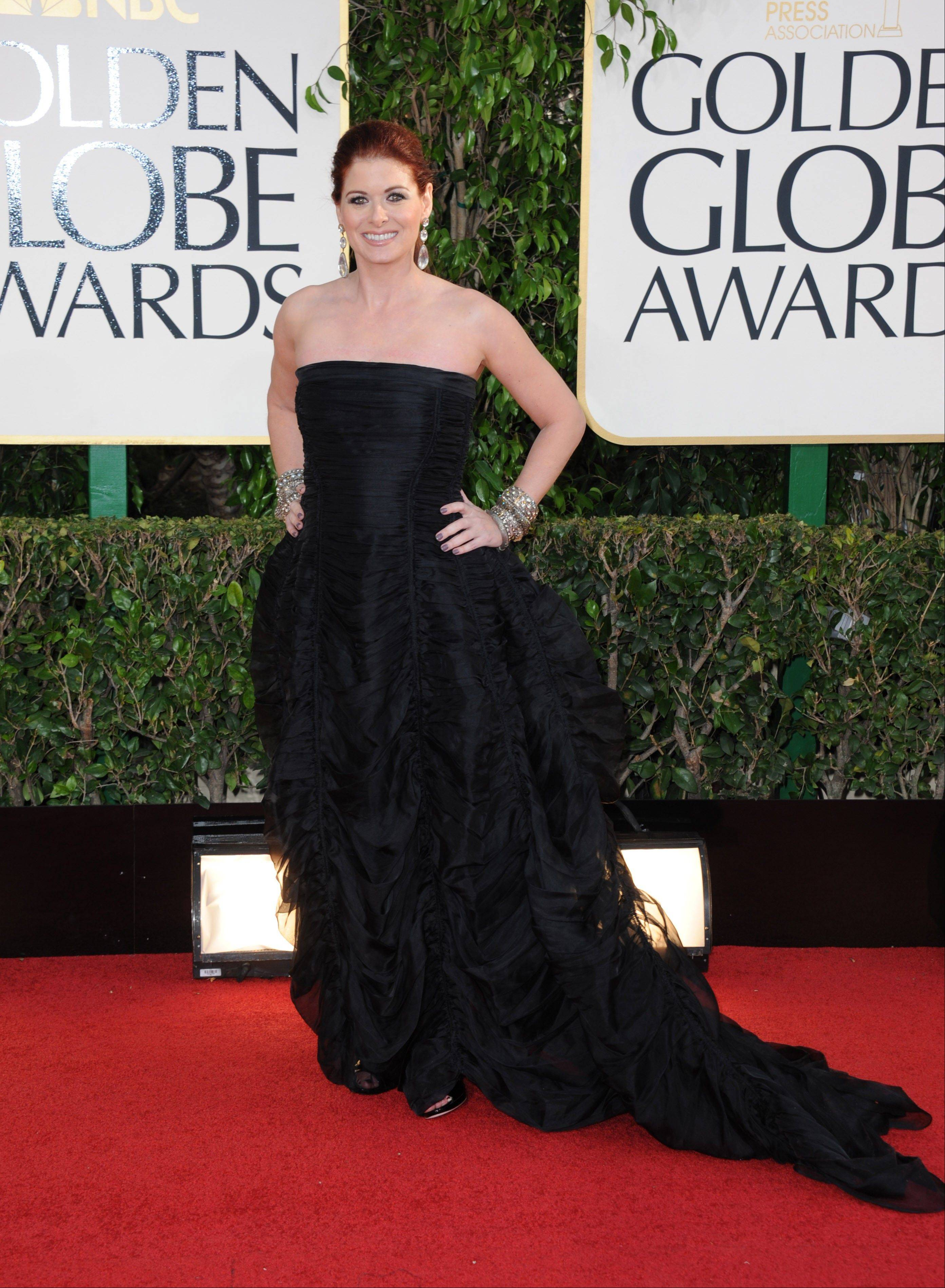 Actress Debra Messing arrives at the 70th Annual Golden Globe Awards at the Beverly Hilton Hotel on Sunday Jan. 13, 2013, in Beverly Hills, Calif.