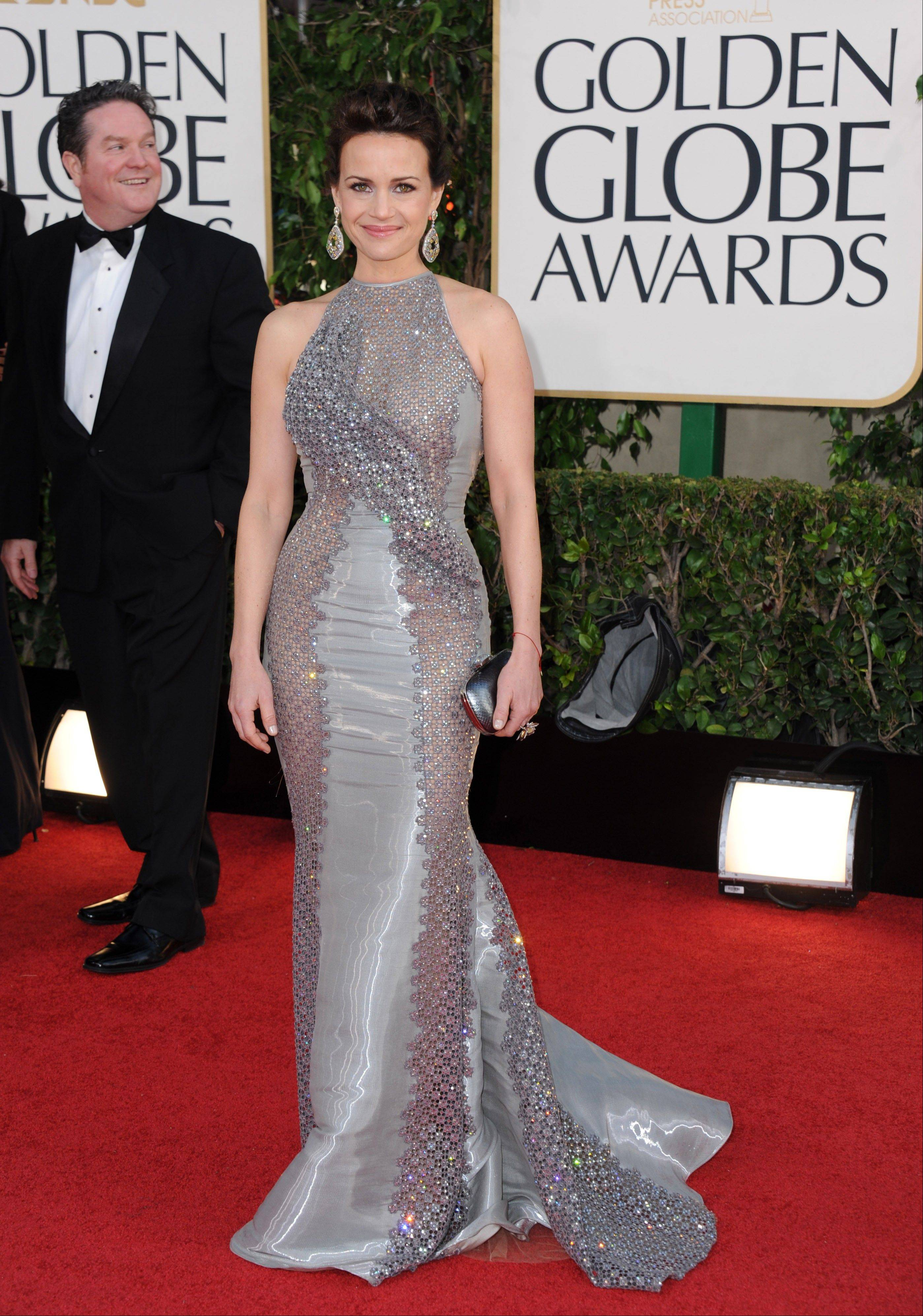 Actress Carla Gugino arrives at the 70th Annual Golden Globe Awards at the Beverly Hilton Hotel on Sunday Jan. 13, 2013, in Beverly Hills, Calif.