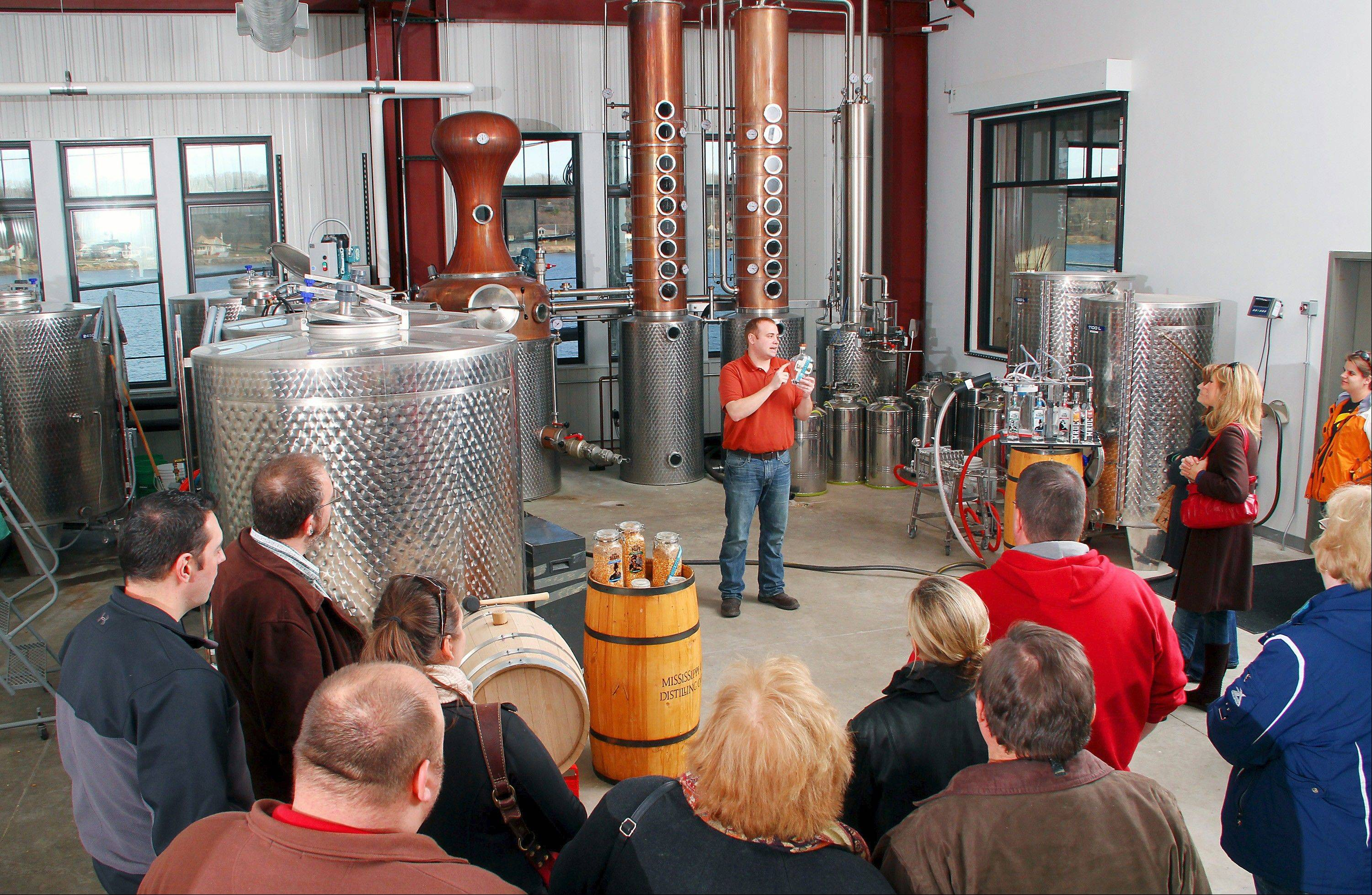 Garrett Burchett takes visitors on a tour of Mississippi River Distilling Co., a micro-distillery he and his brother opened in Le Claire, Iowa.