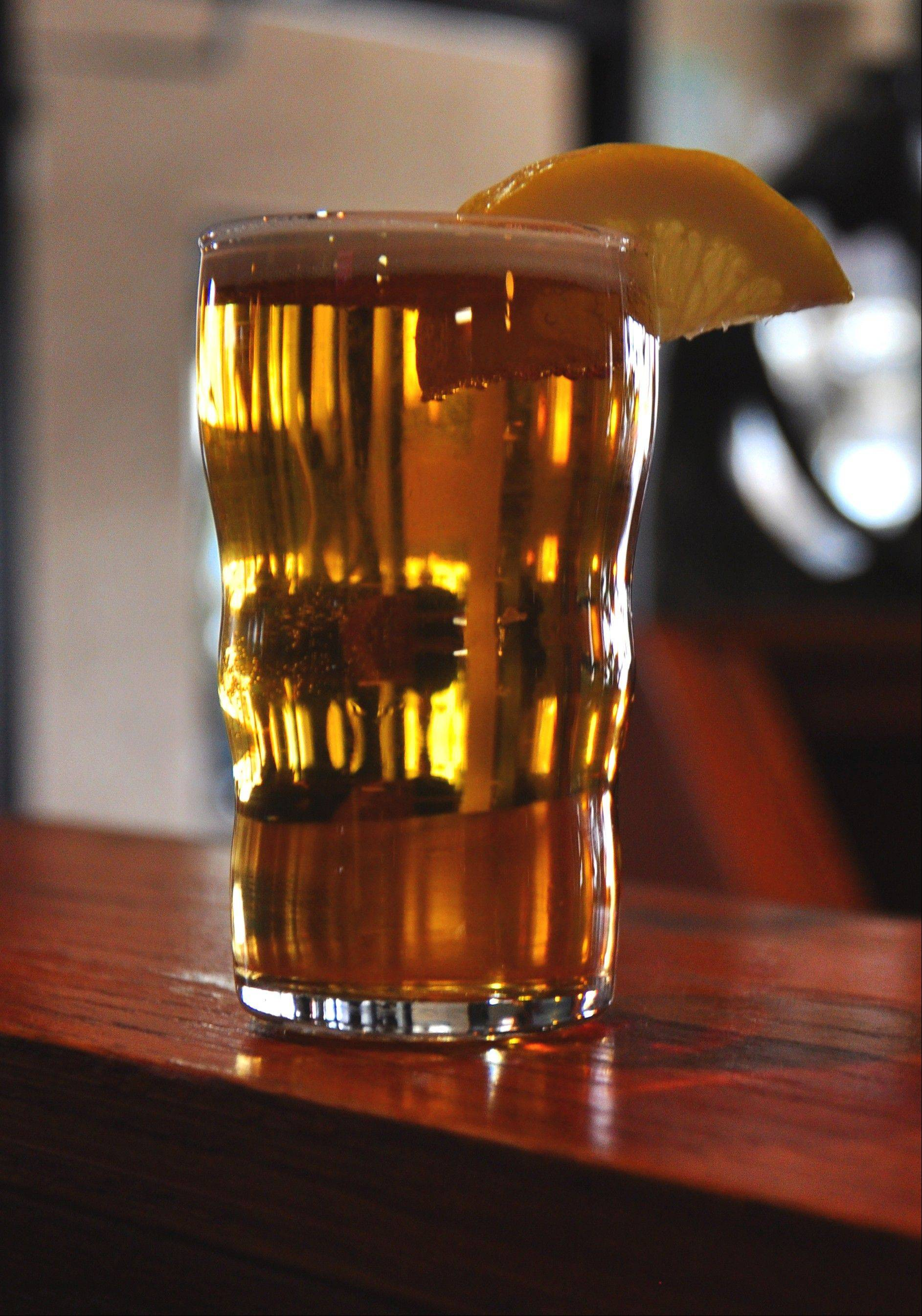 Wigged Pig Wheat beer is served with a slice of lemon. It's one of several craft beers made at the Blue Cat Brew Pub in Rock Island.