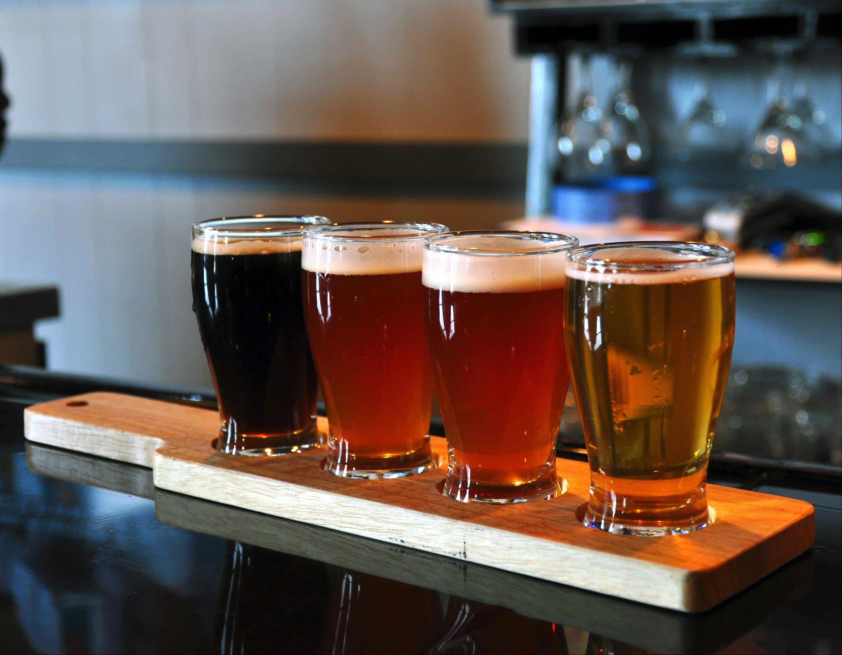 Order four, 5-ounce flights of Bent River Brewing Co. beer at its tasting room in Rock Island.