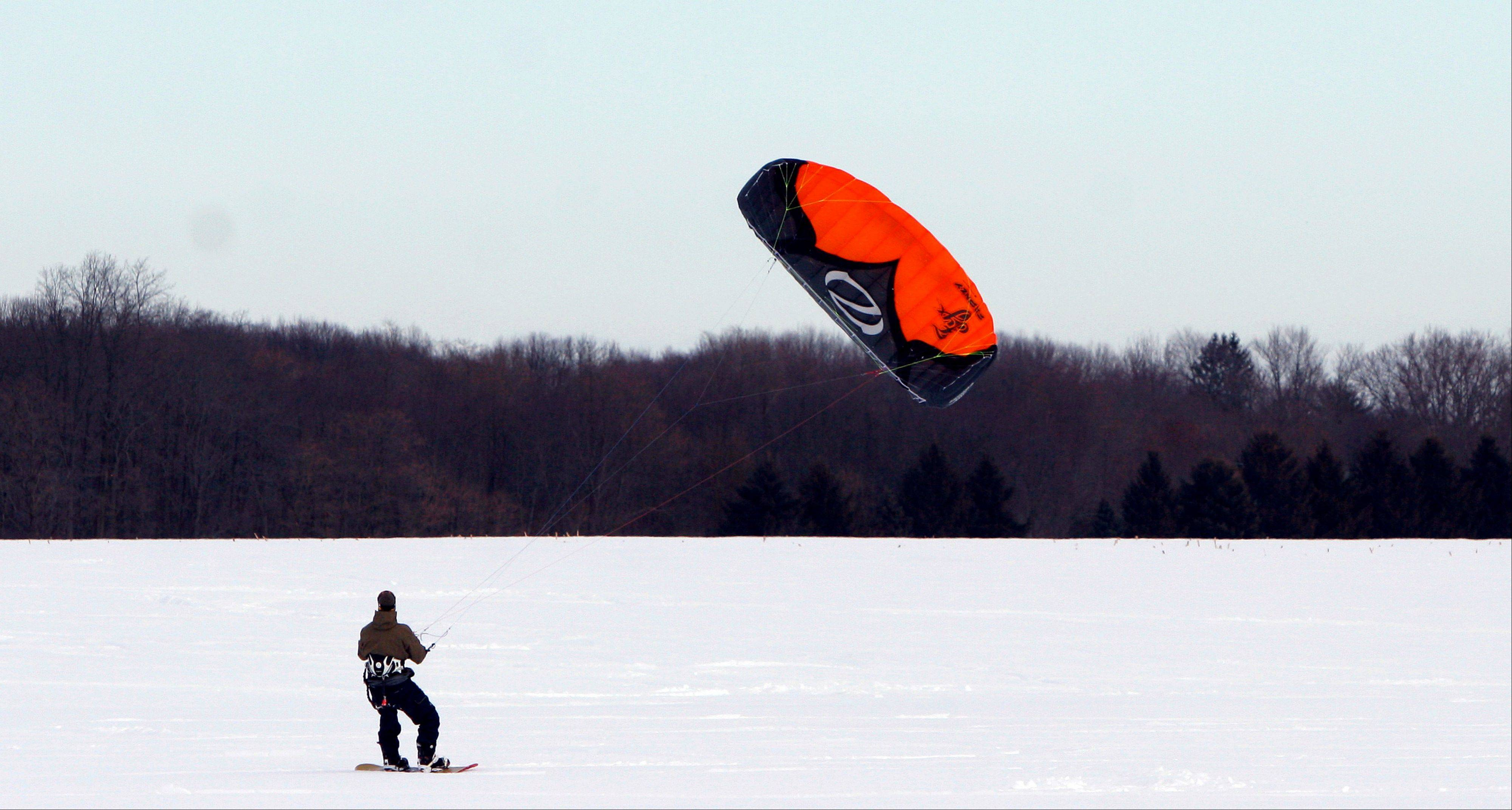 John O'Malley, from Westchester County, N.Y, snowkites across an open field in Cranbury, N.J.