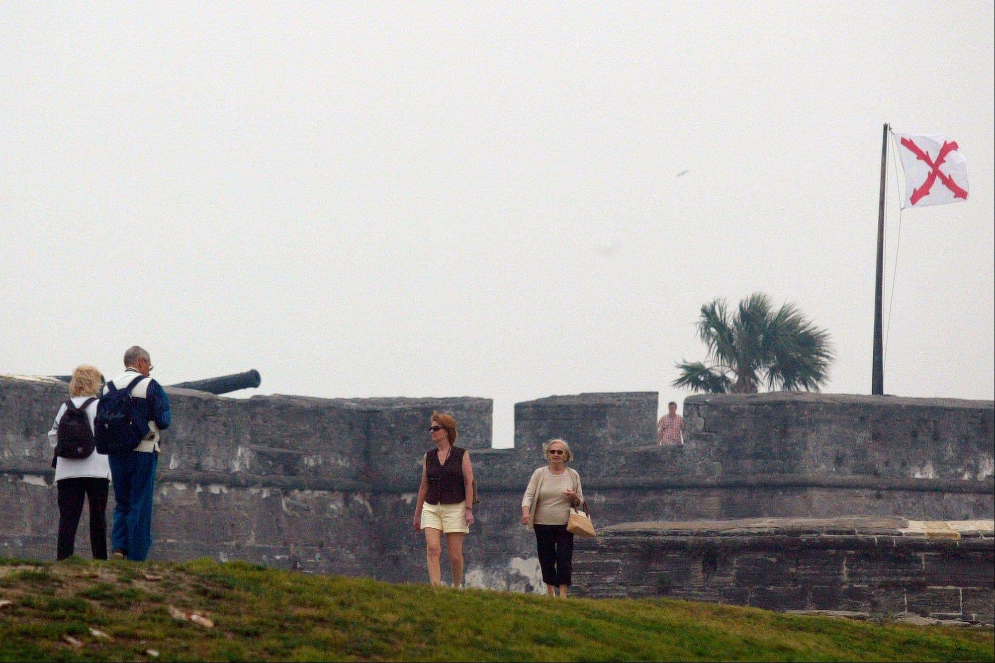 Visitors tour the Castillo de San Marcos in St. Augustine, Fla. The Spanish built the Castillo de San Marcos, an imposing fort constructed of the stone coquina between 1672 and 1696.