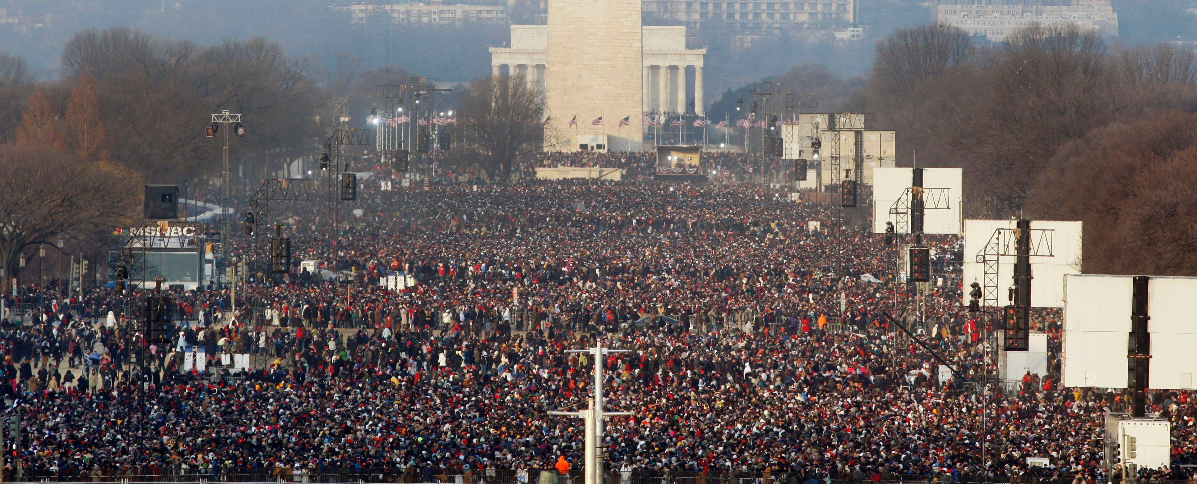 This Jan. 20, 2009, file photo shows the crowd on the National Mall in Washington for the swearing-in ceremony of President-elect Barack Obama. Four years and one re-election after Obama became America's first black president, some of the thrill is gone. Yes, the inauguration of a U.S. president is still a big deal.